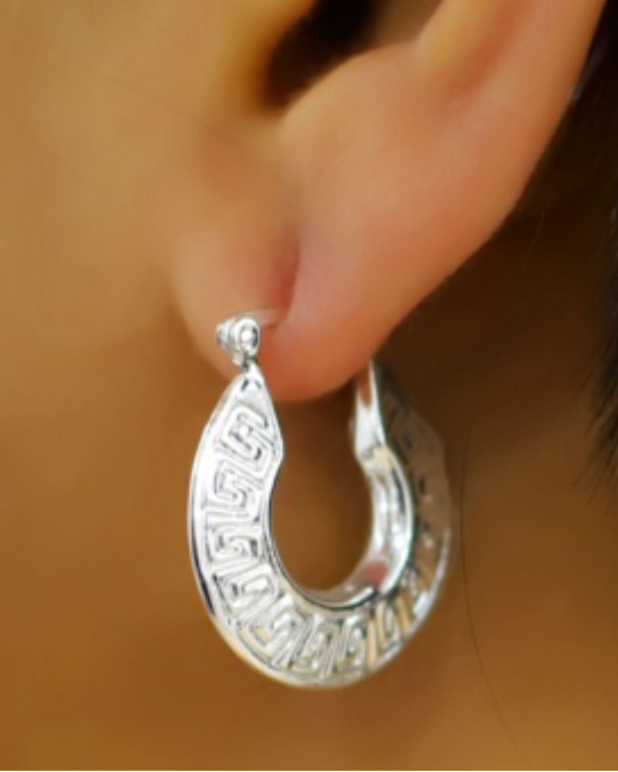 Silver carved hoop earrings