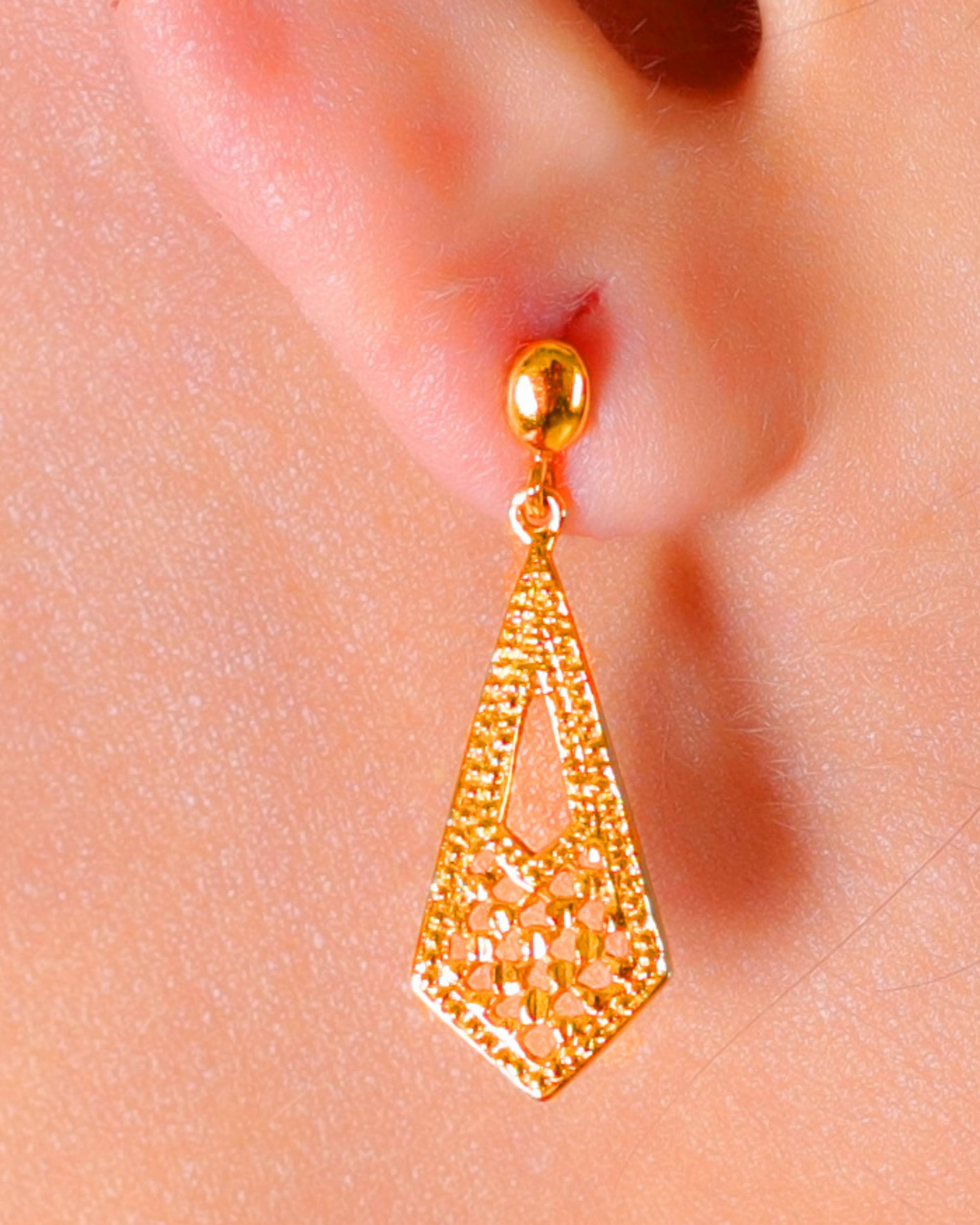 Carved kite earrings
