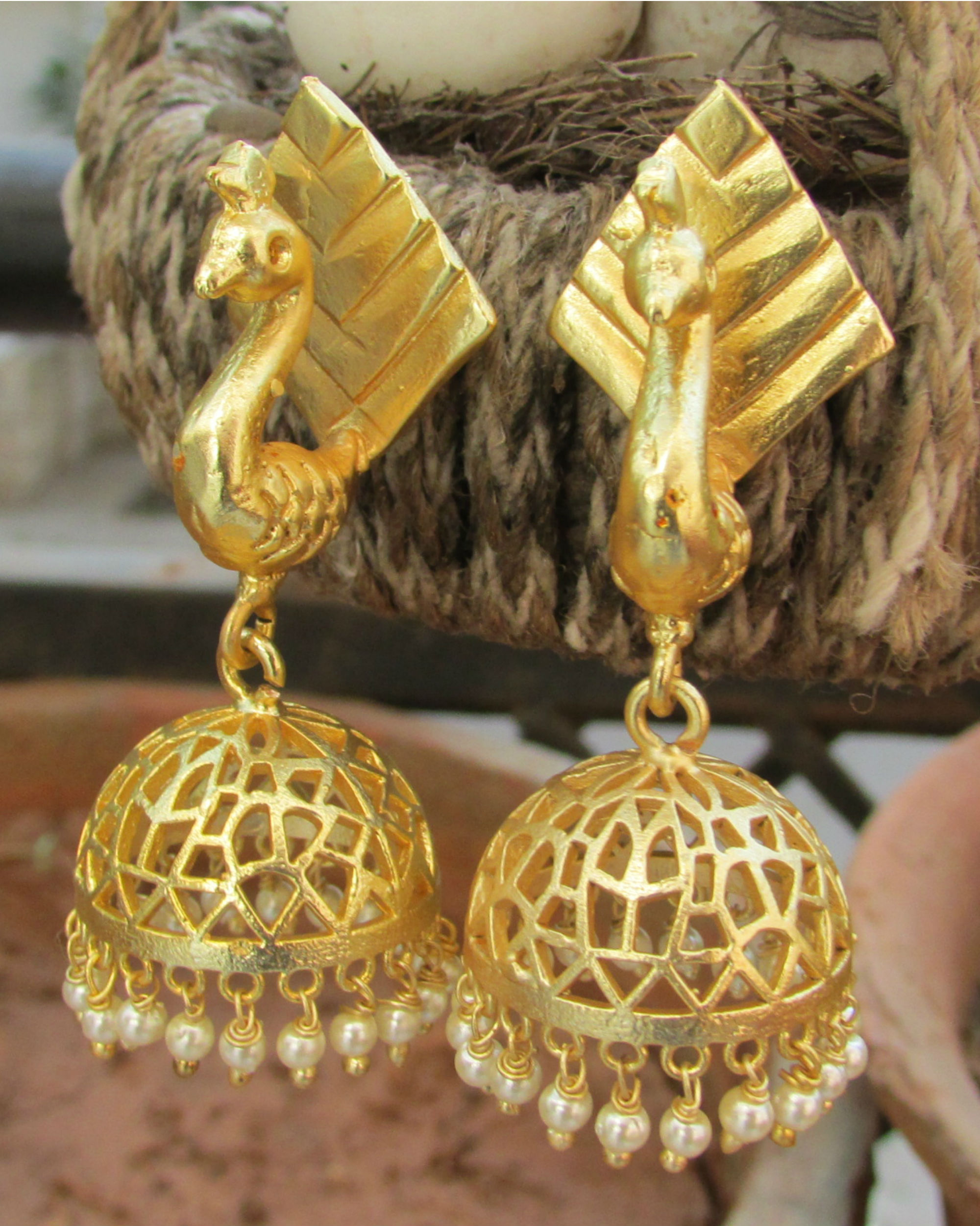 Golden peacock jhumkas