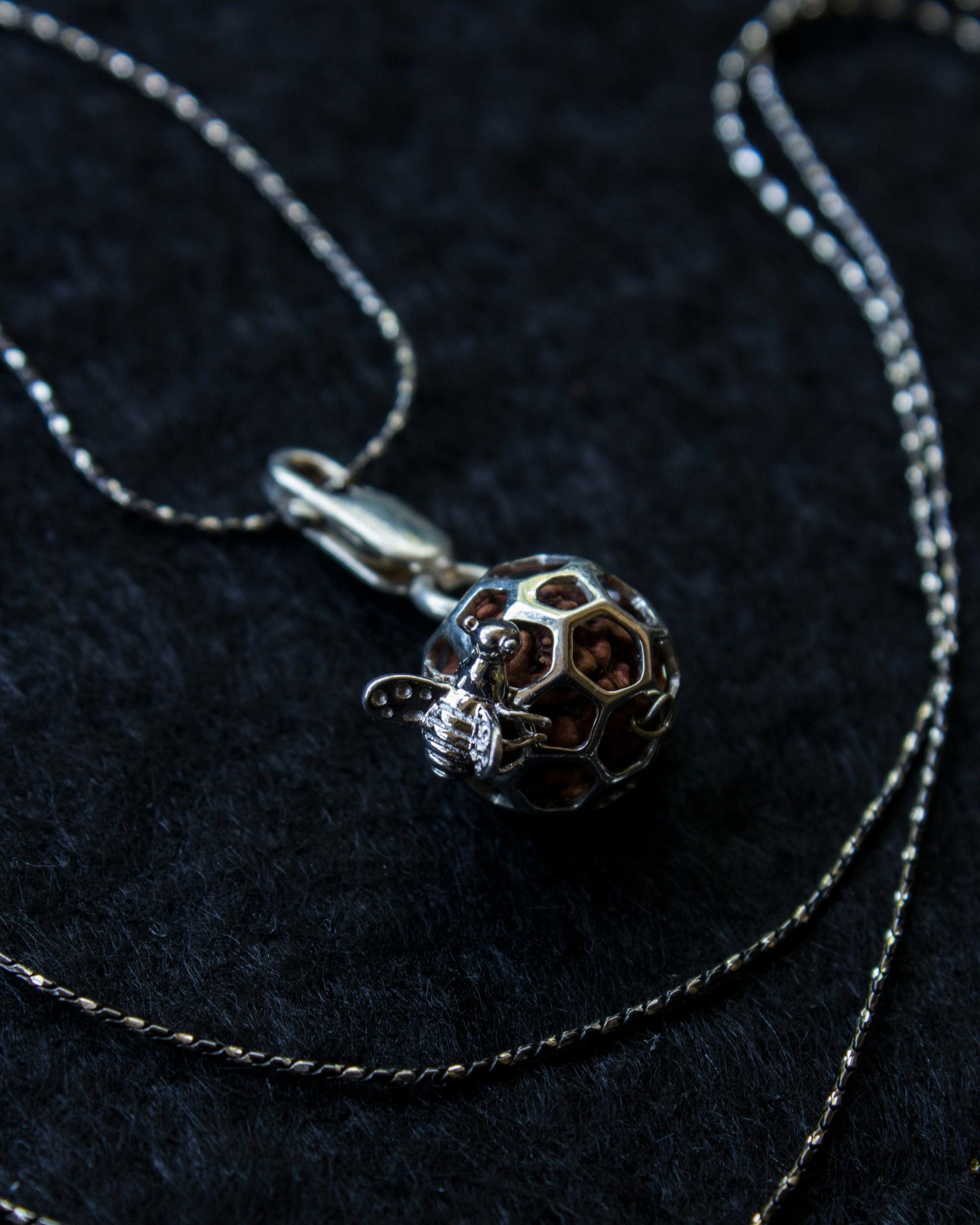 Silver hive pendant