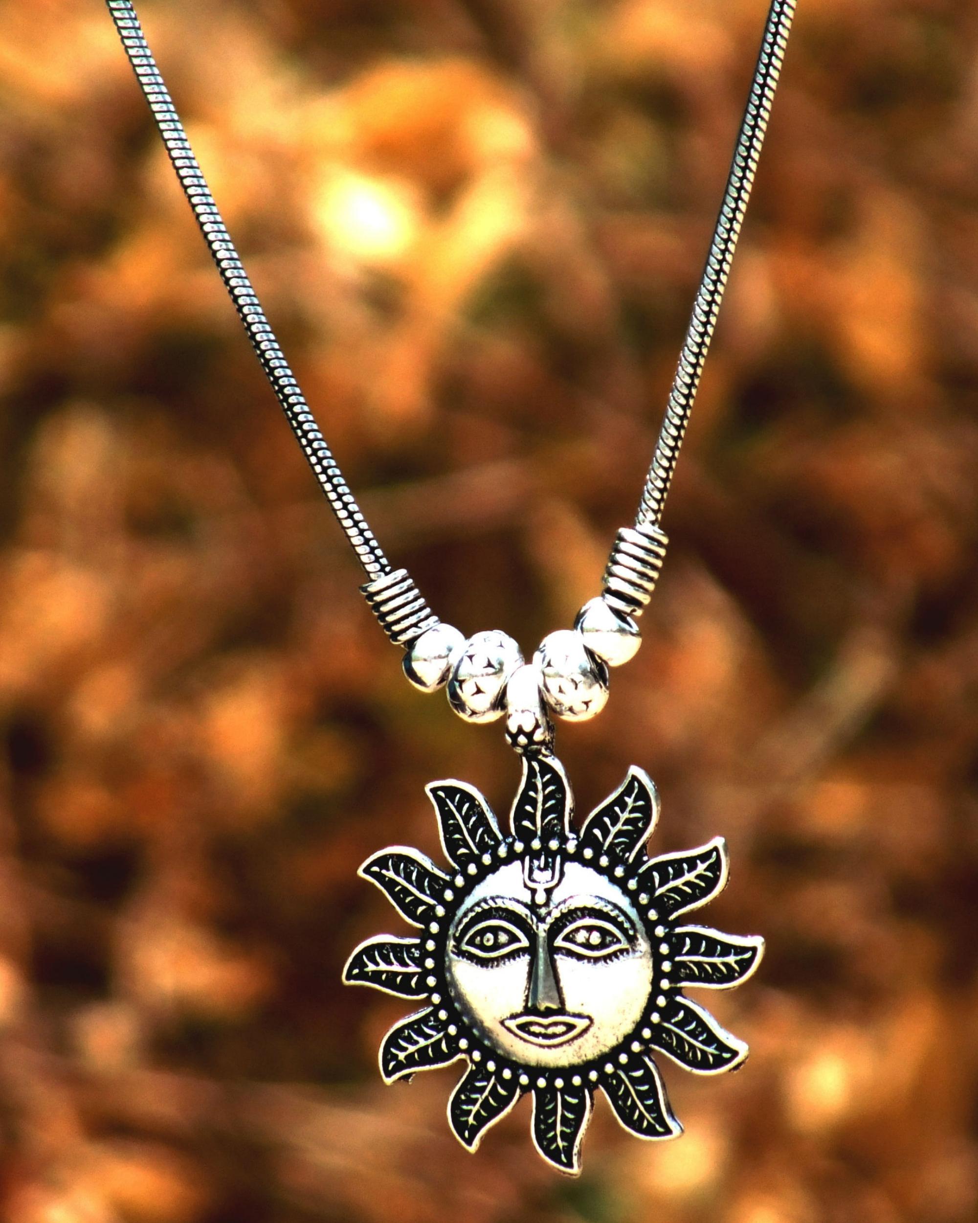 Silver sun pendant necklace