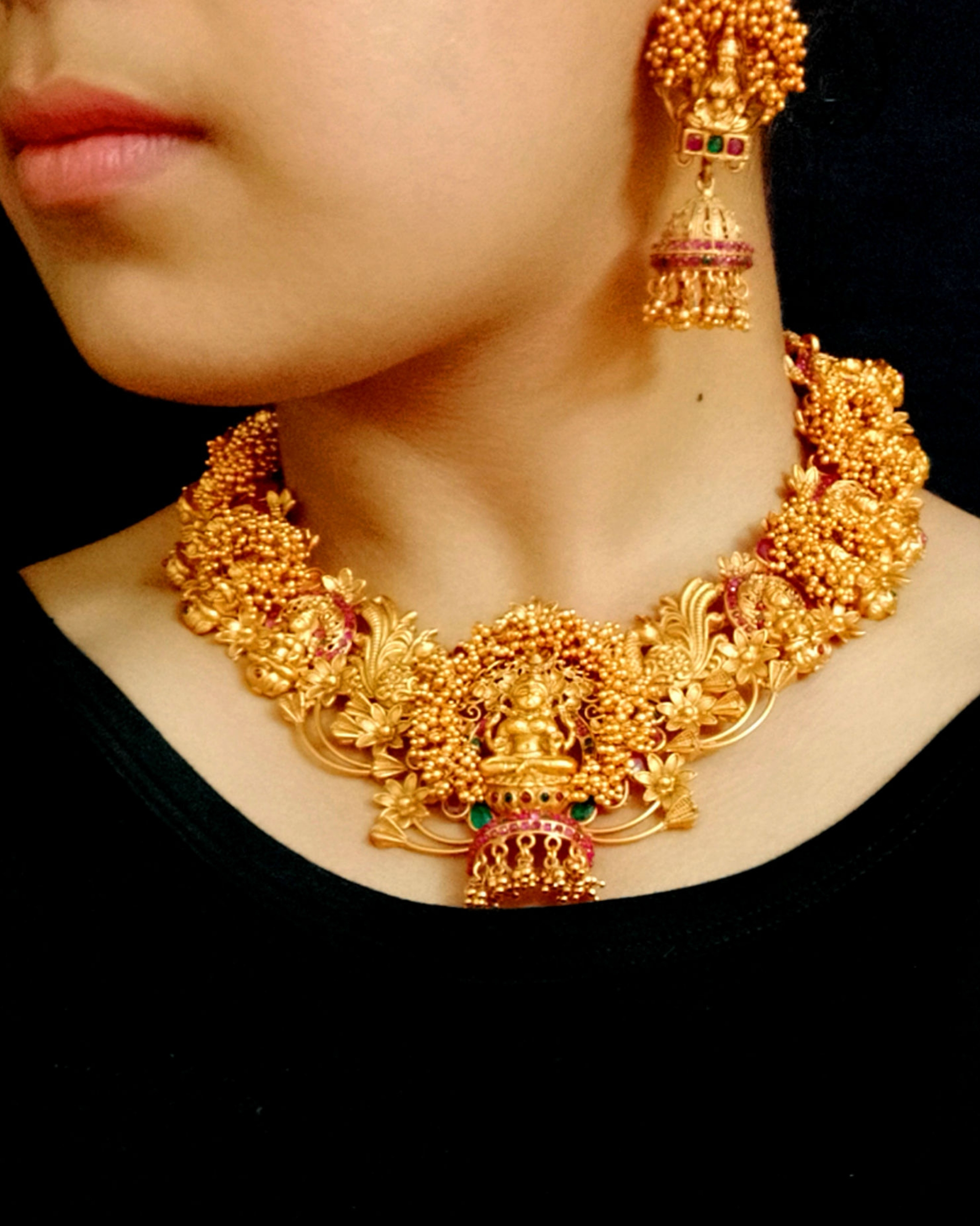 Intricate antique gold necklace and earrings set