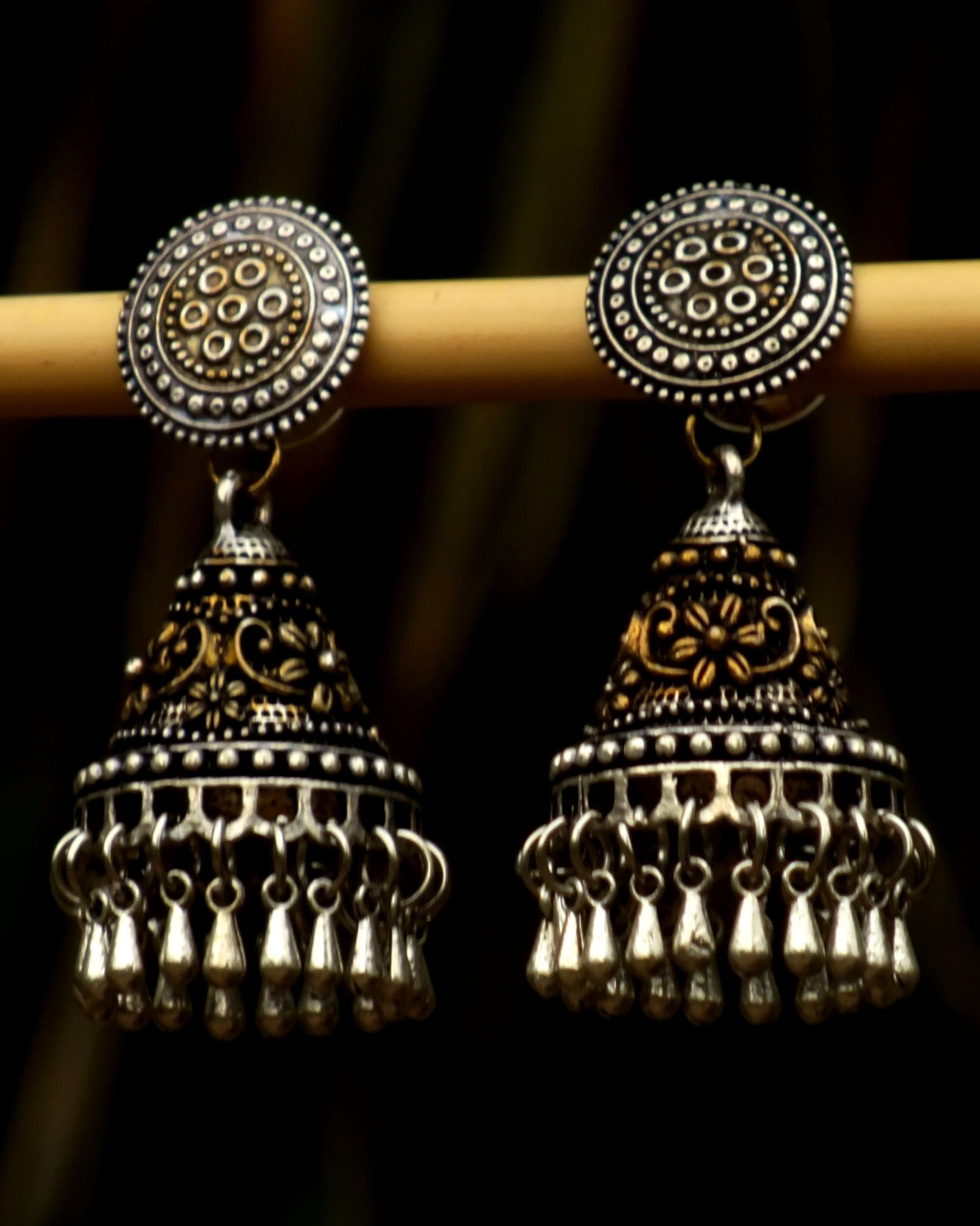 Intricate gold and silver oxidized earrings