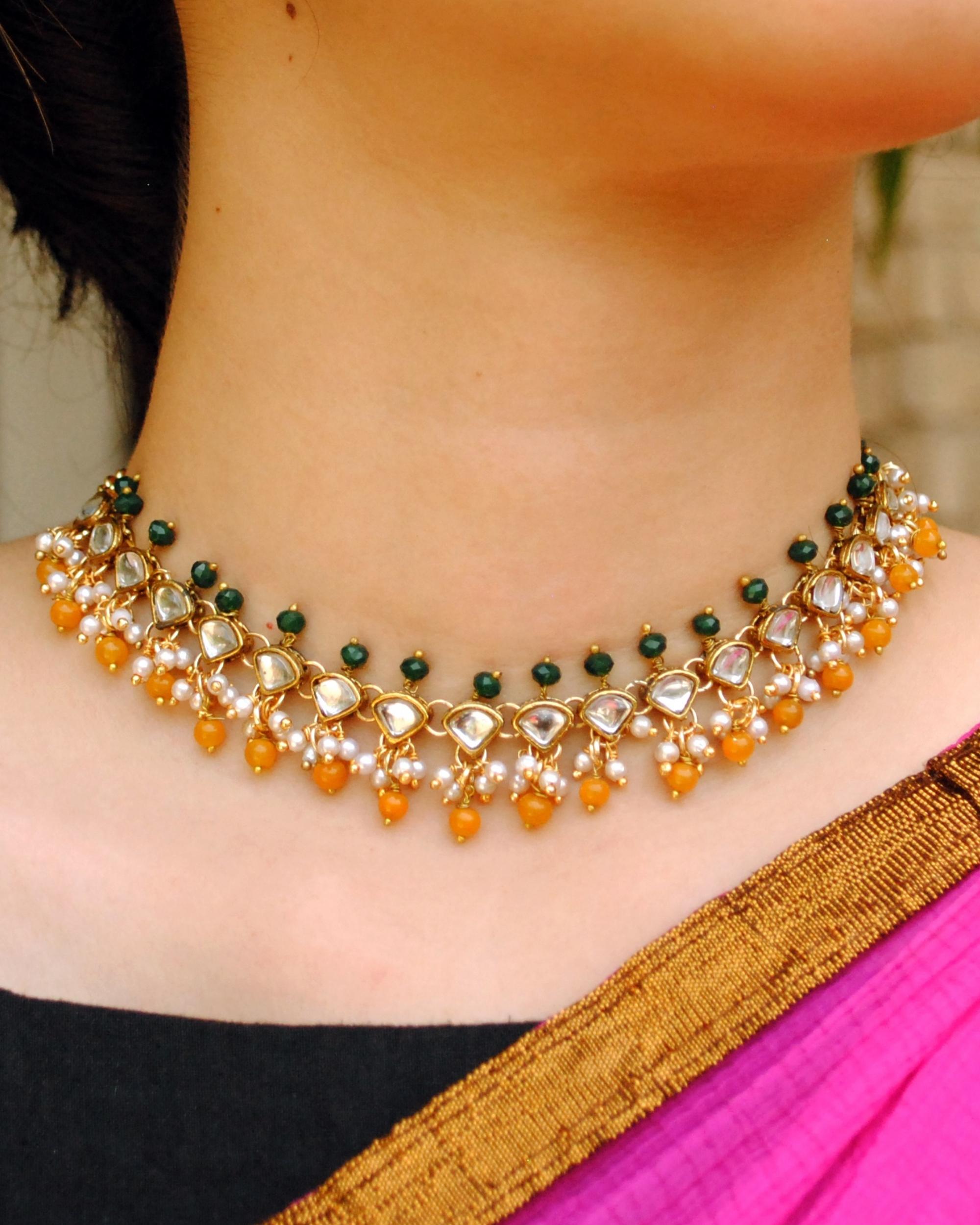 Green and orange beaded kundan necklace