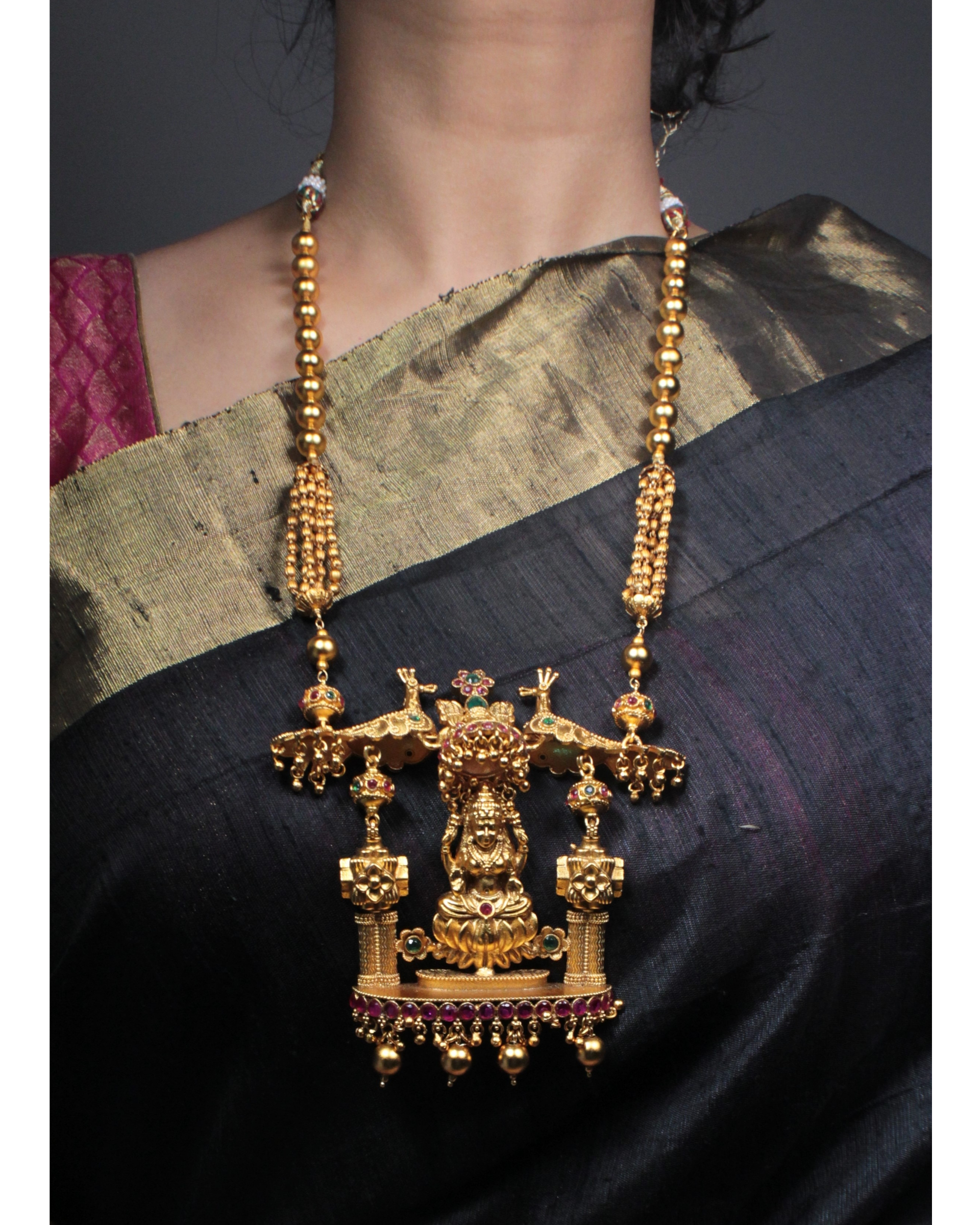 Lakshmi and peacock motif necklace and earring set - set of two