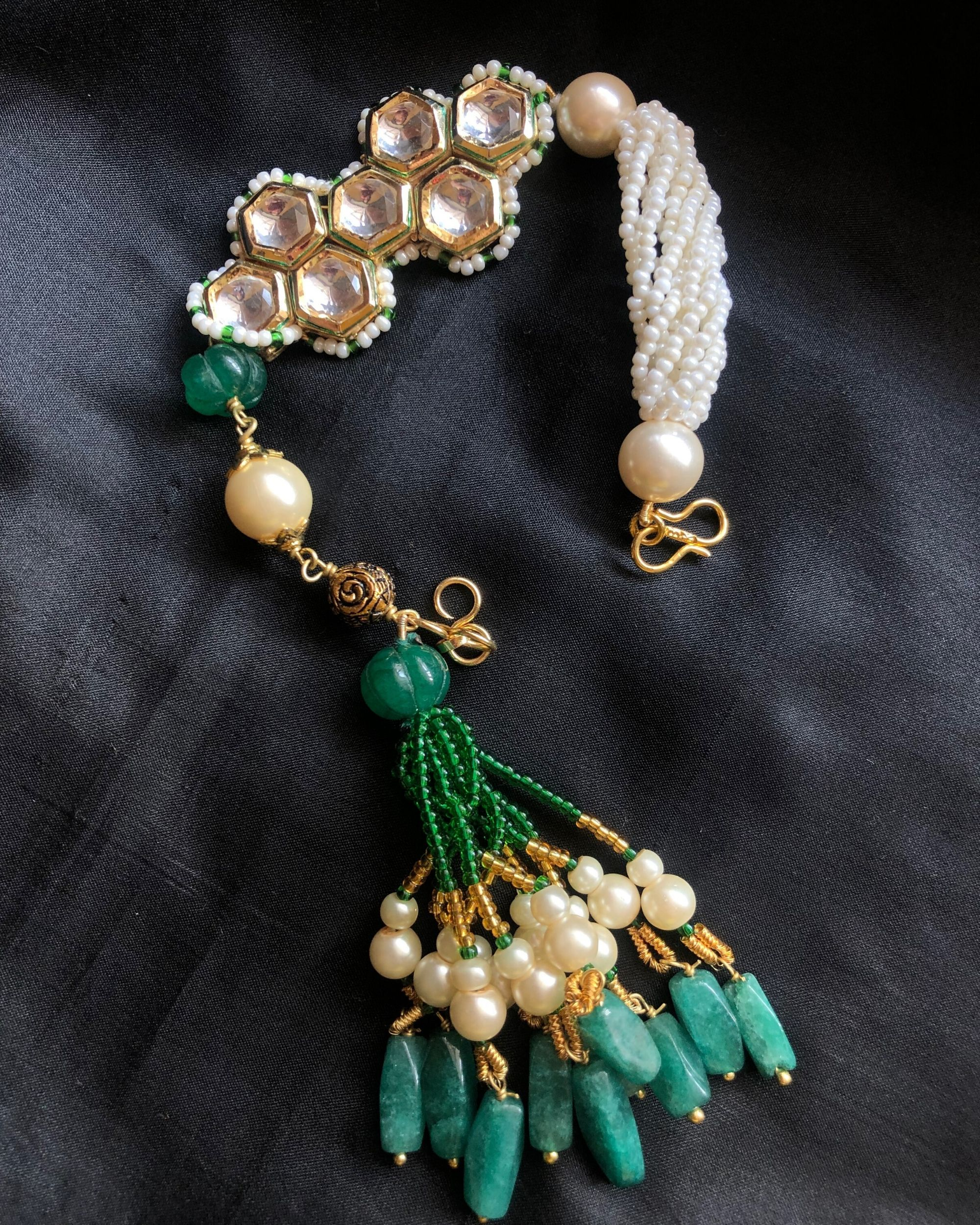 Kundan and pearls bracelet with green stones