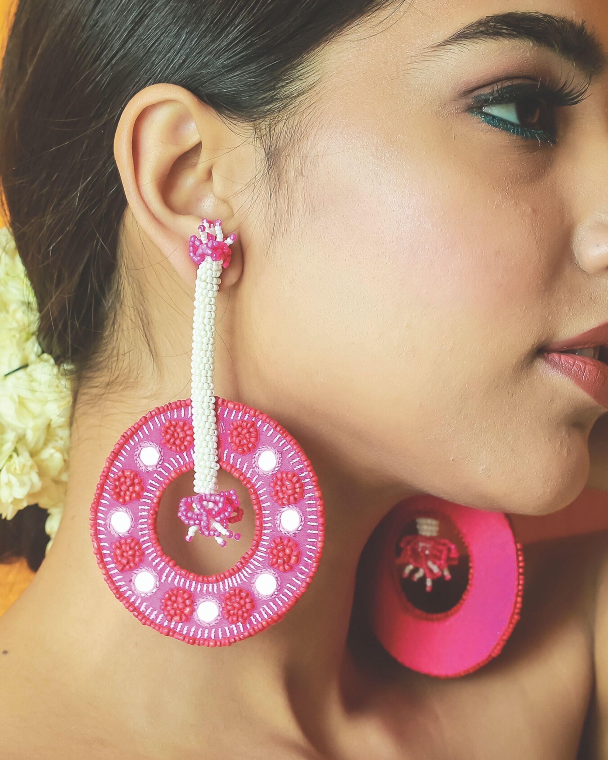 Fuchsia pink beaded circular dangler earrings