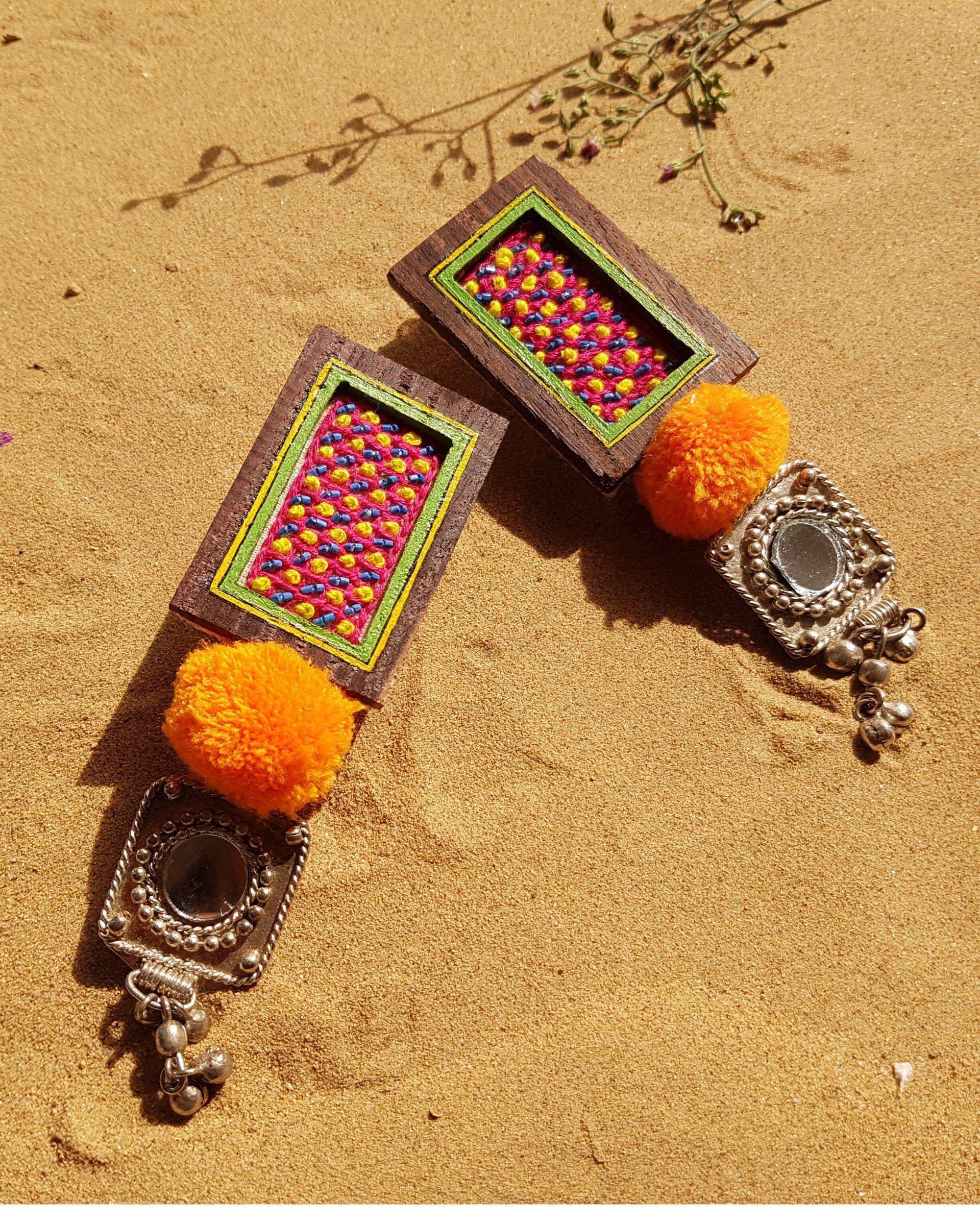 Hand embroidered pom pom earrings