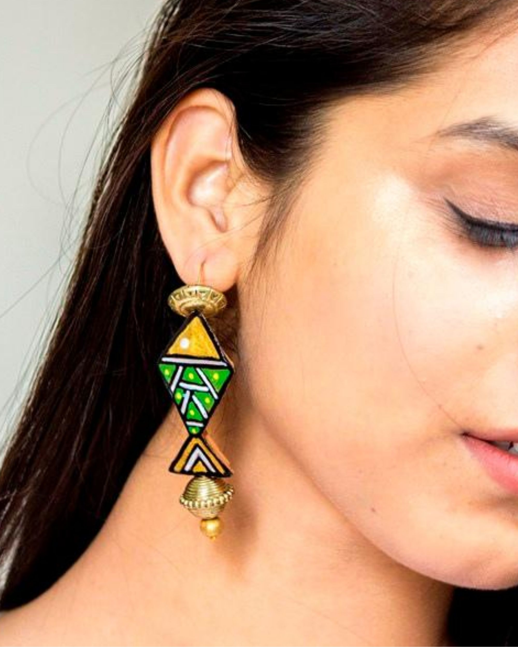 Green and yellow fish terracotta earring