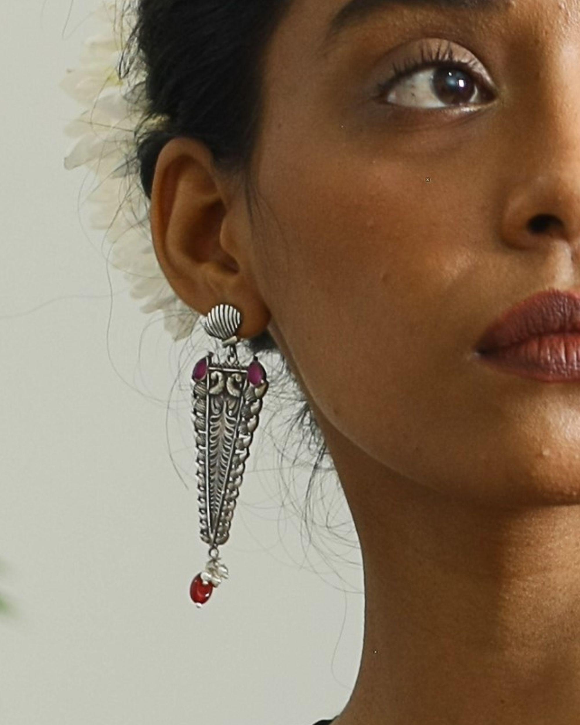 Trigon shaped peacock motif earring