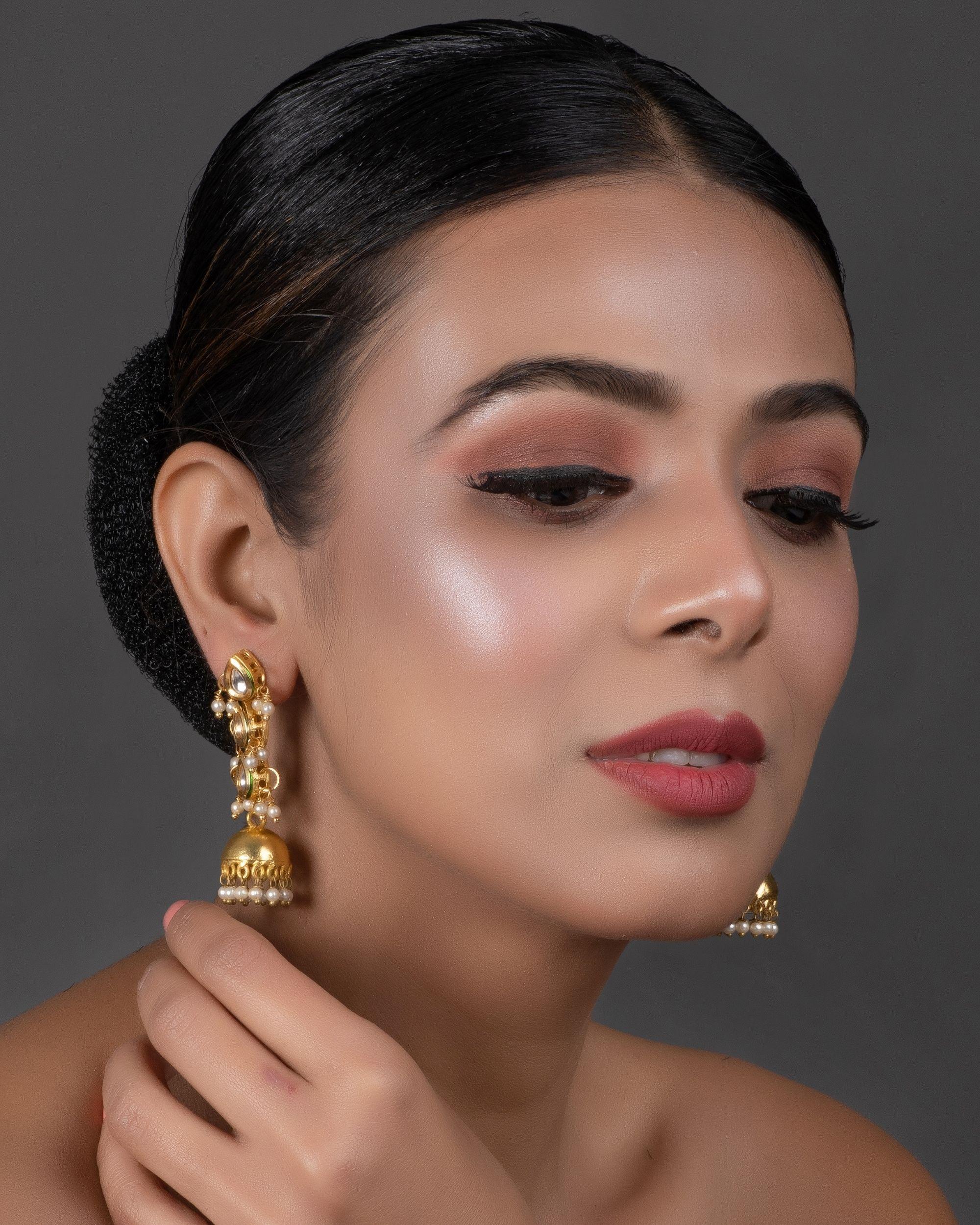 Thilak tiered kundan and pearl jhumkha