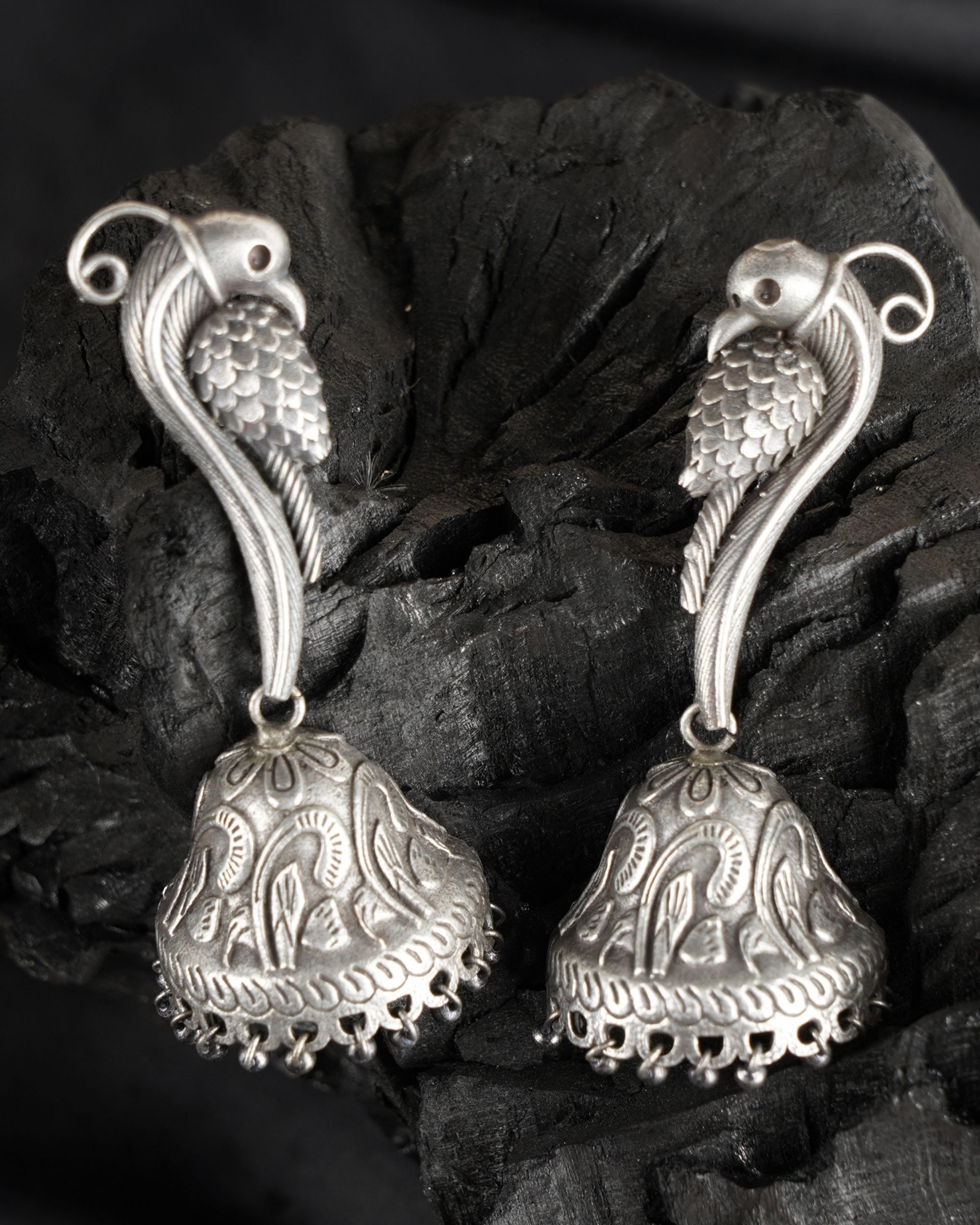 Peacock engraved brass jhumka