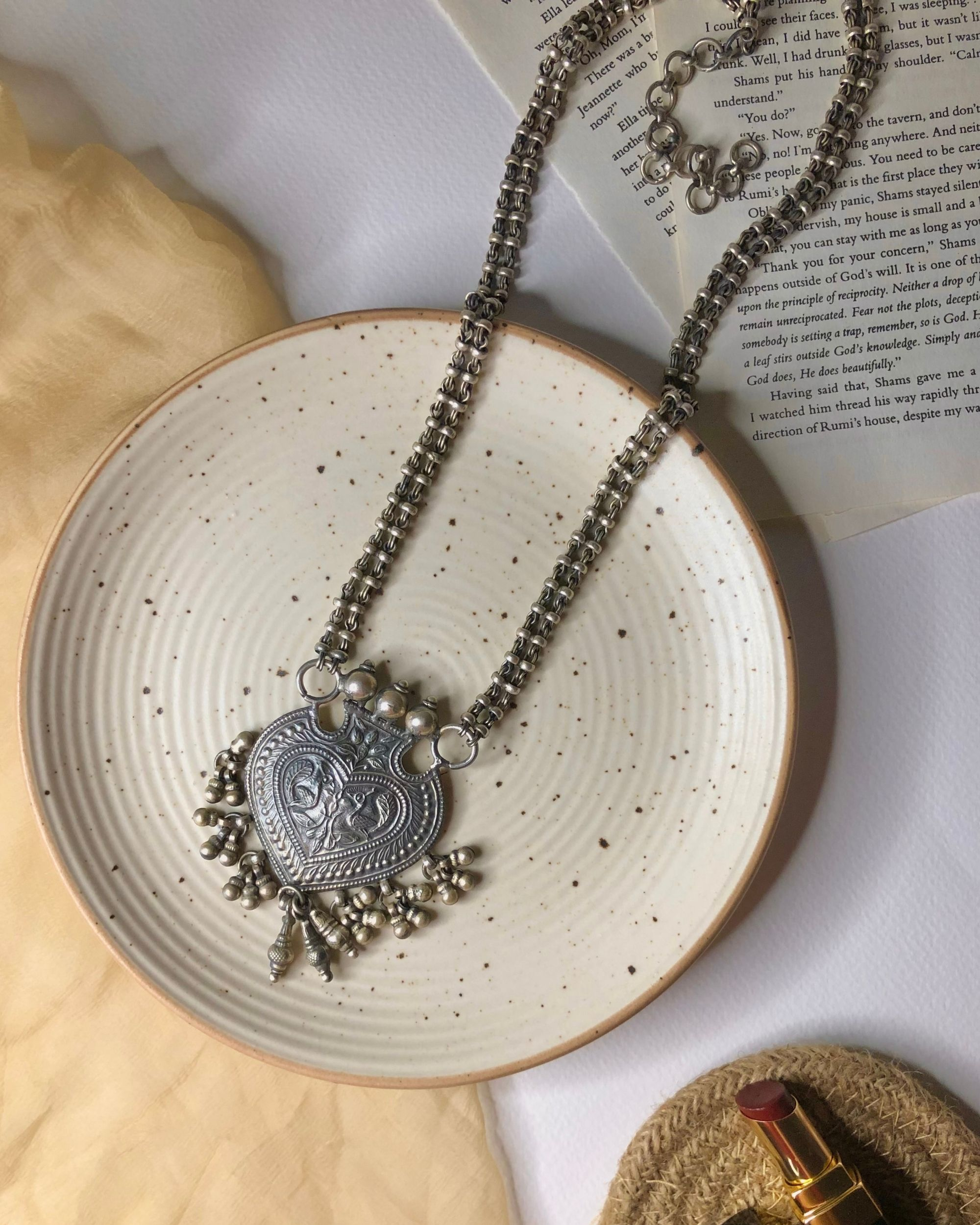 Betel motif peacock engraved long tiered necklace
