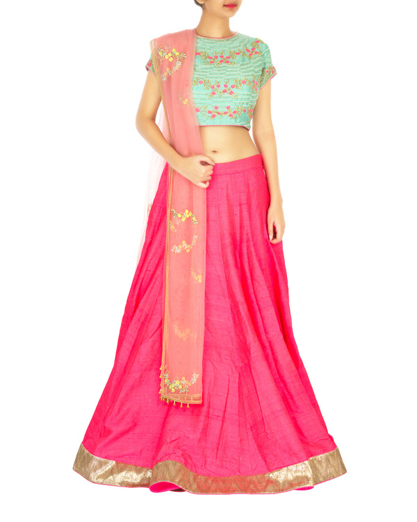 Turquoise and hot pink lehenga set with spiral flower butta
