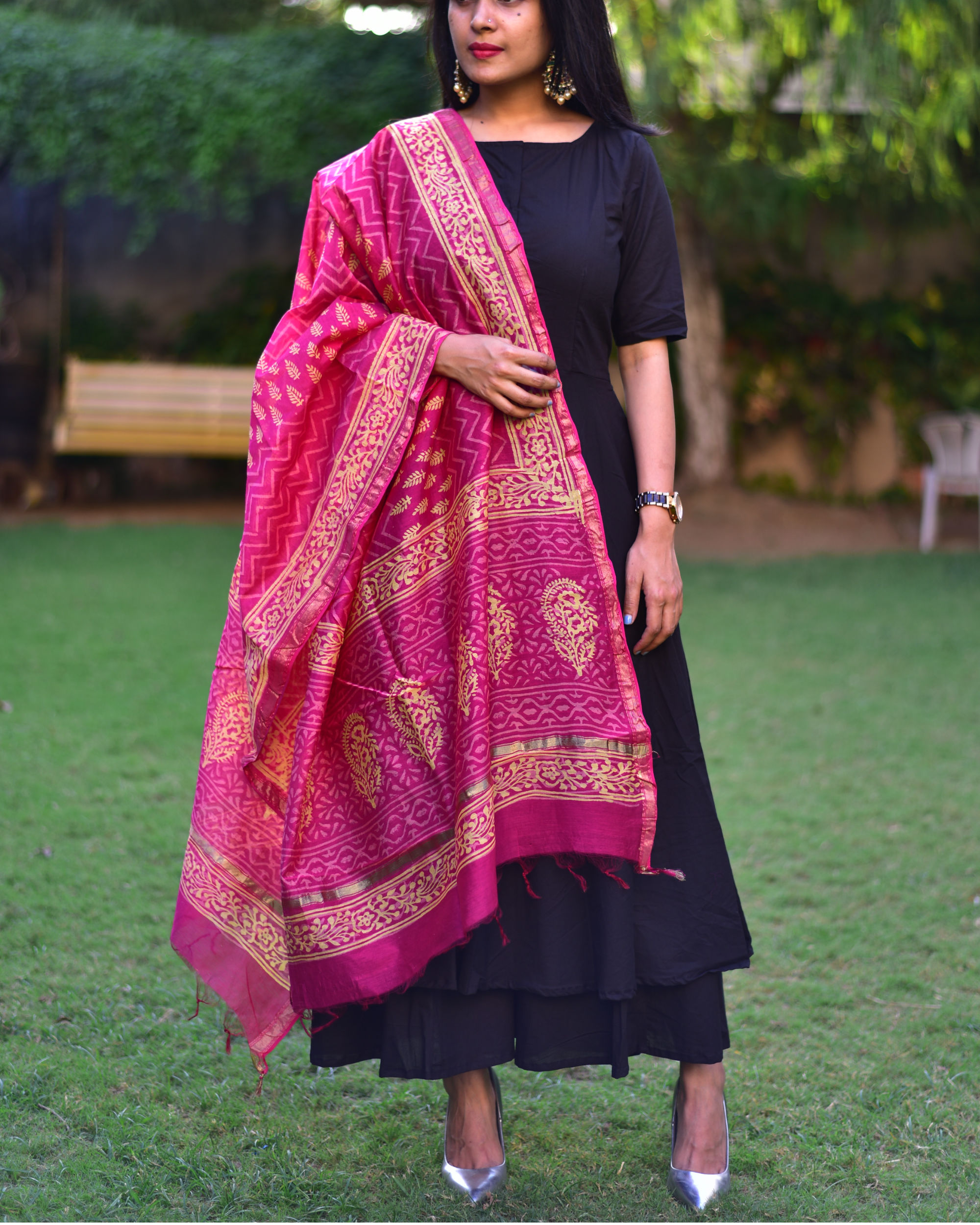 Black suit set with pink dupatta