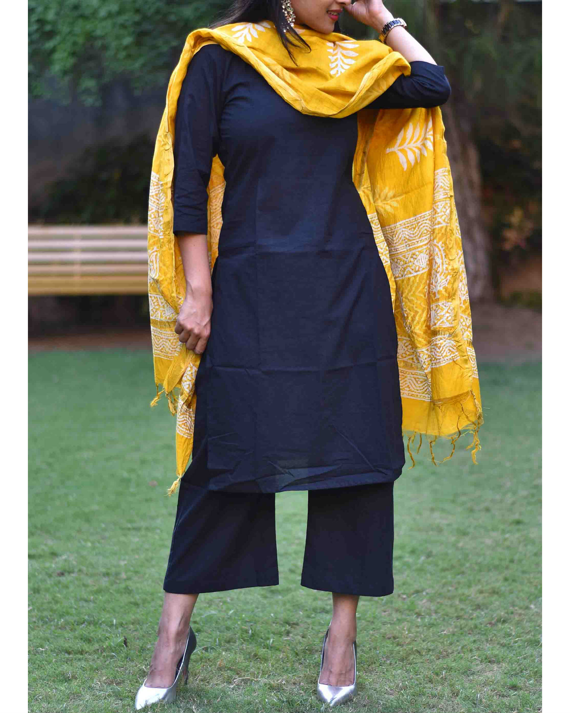 Black suit set with yellow dupatta