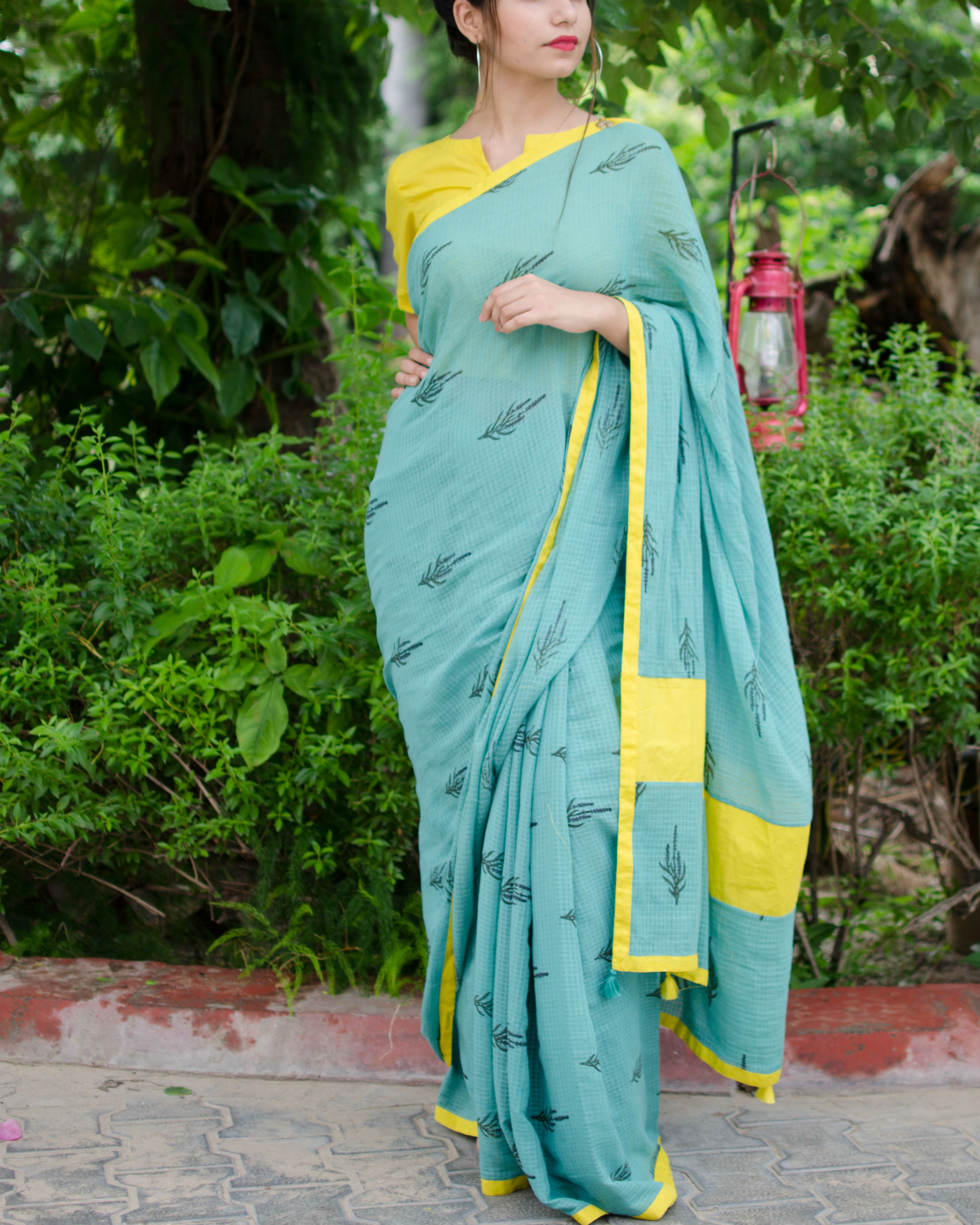 Turquoise sari with crop top blouse.