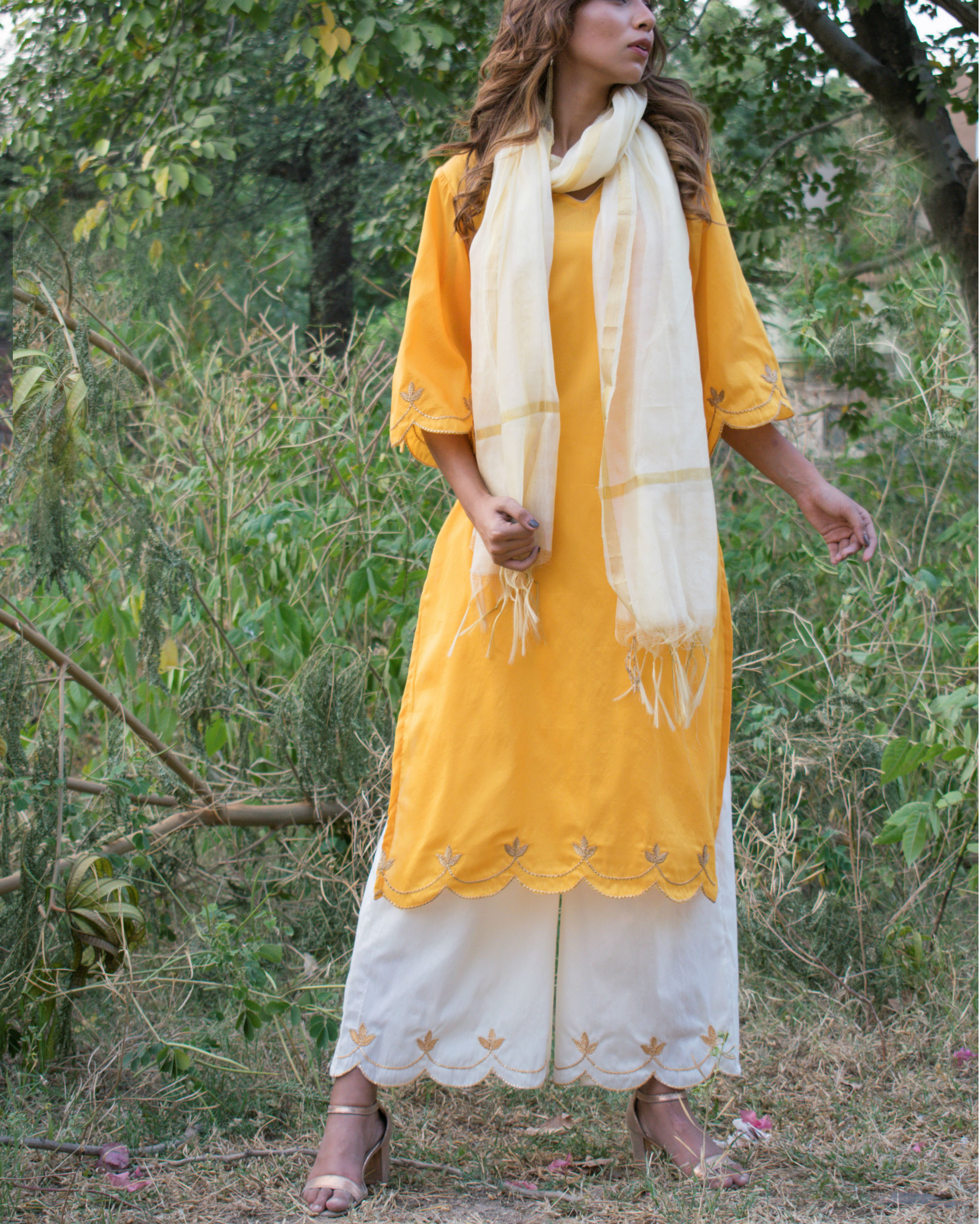 Yellow and off white cut work set with dupatta