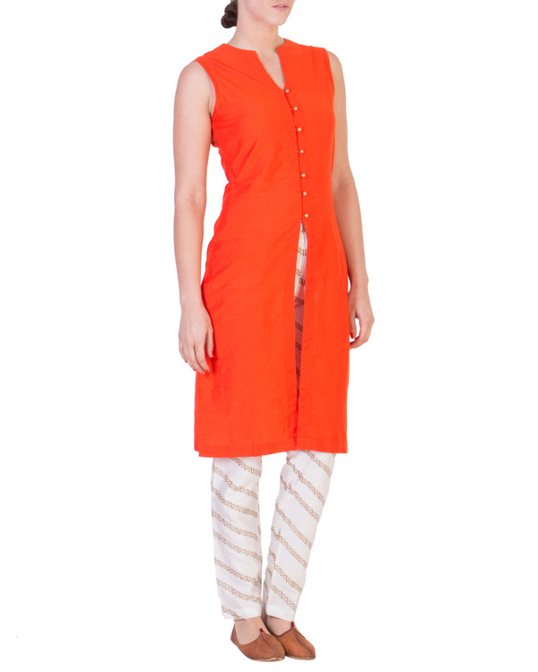 Orange solid straight tunic with tapered printed pants in off white