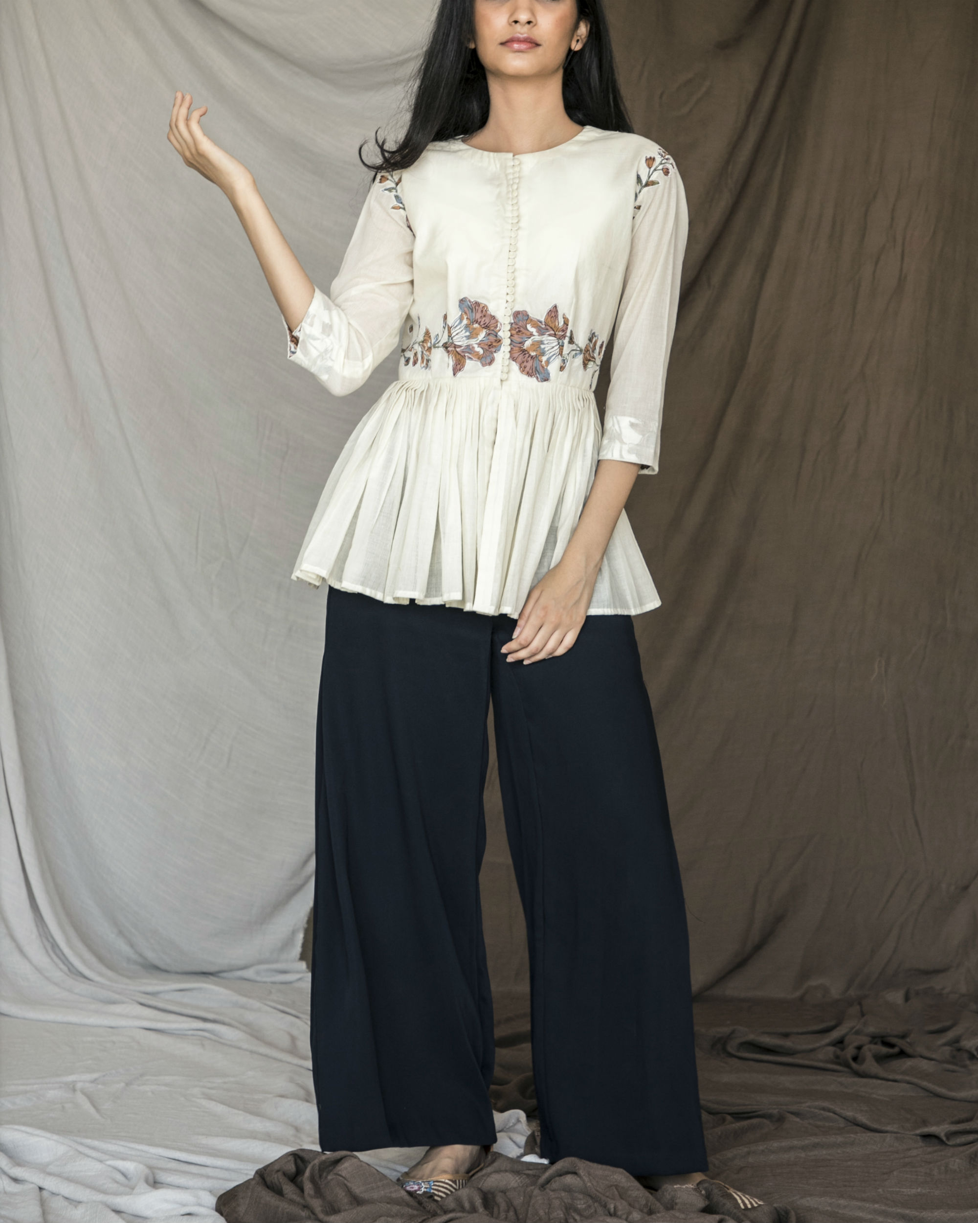 White pleated peplum top with patch work
