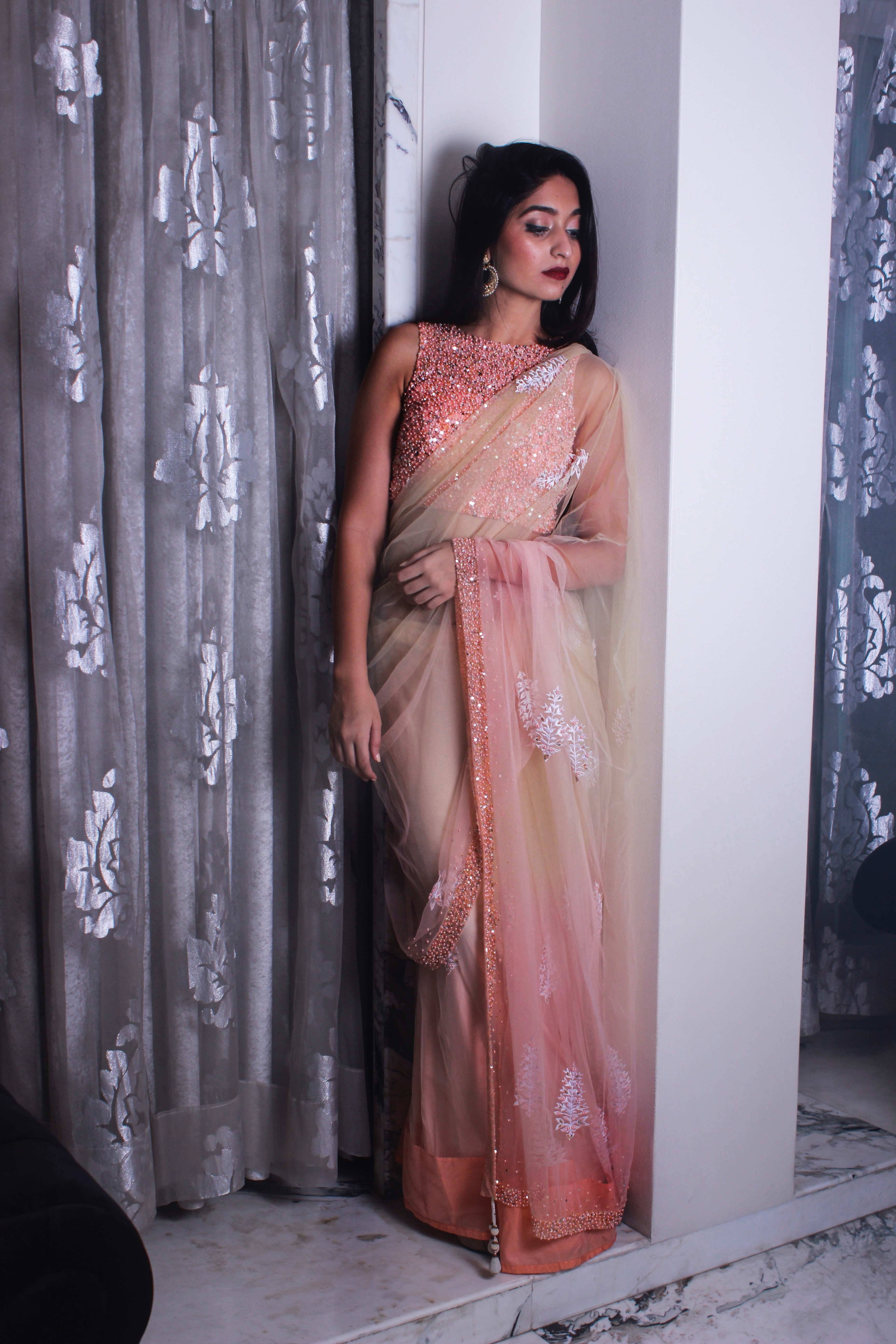 Peach blouse with shaded sari