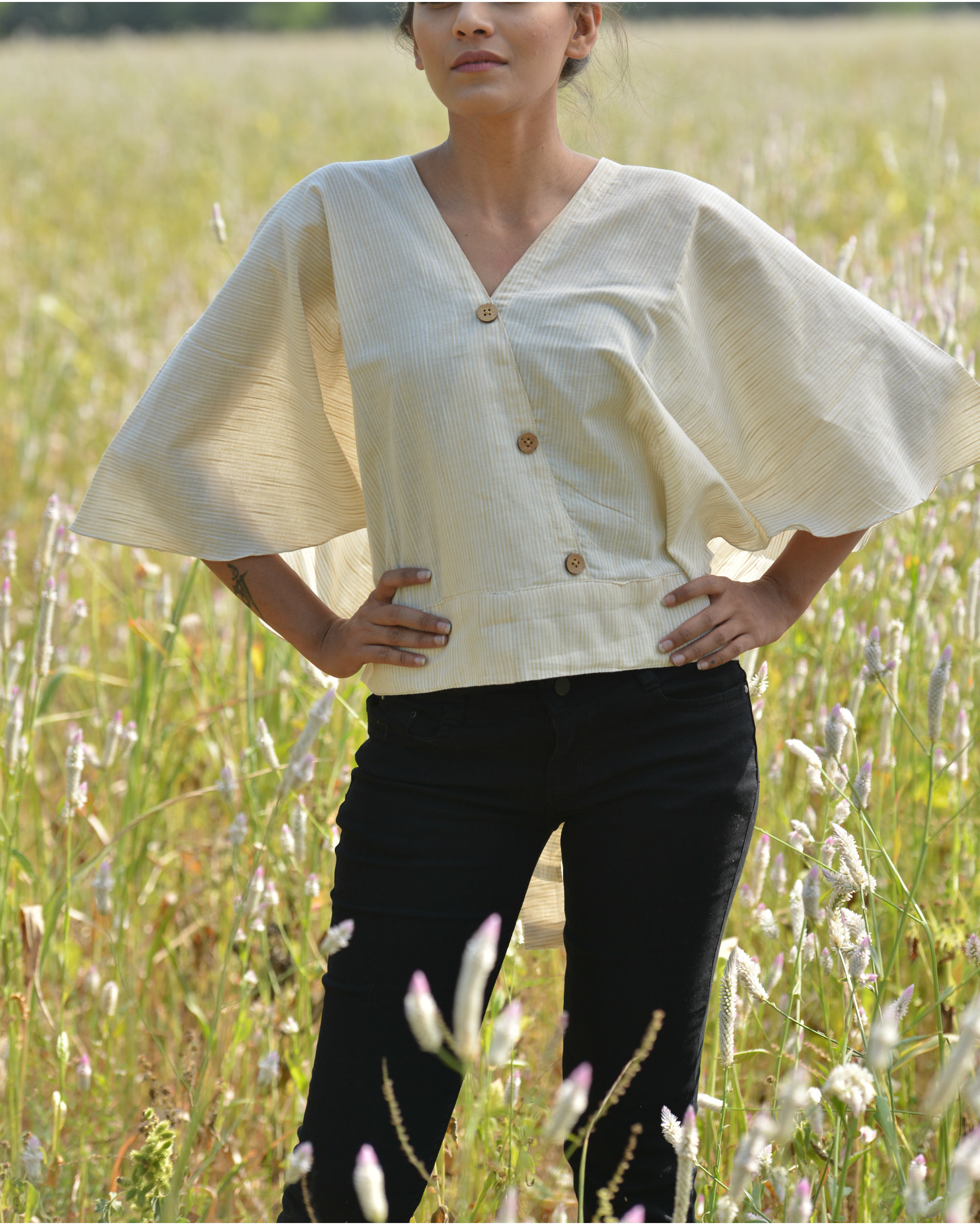 Beige back bow top