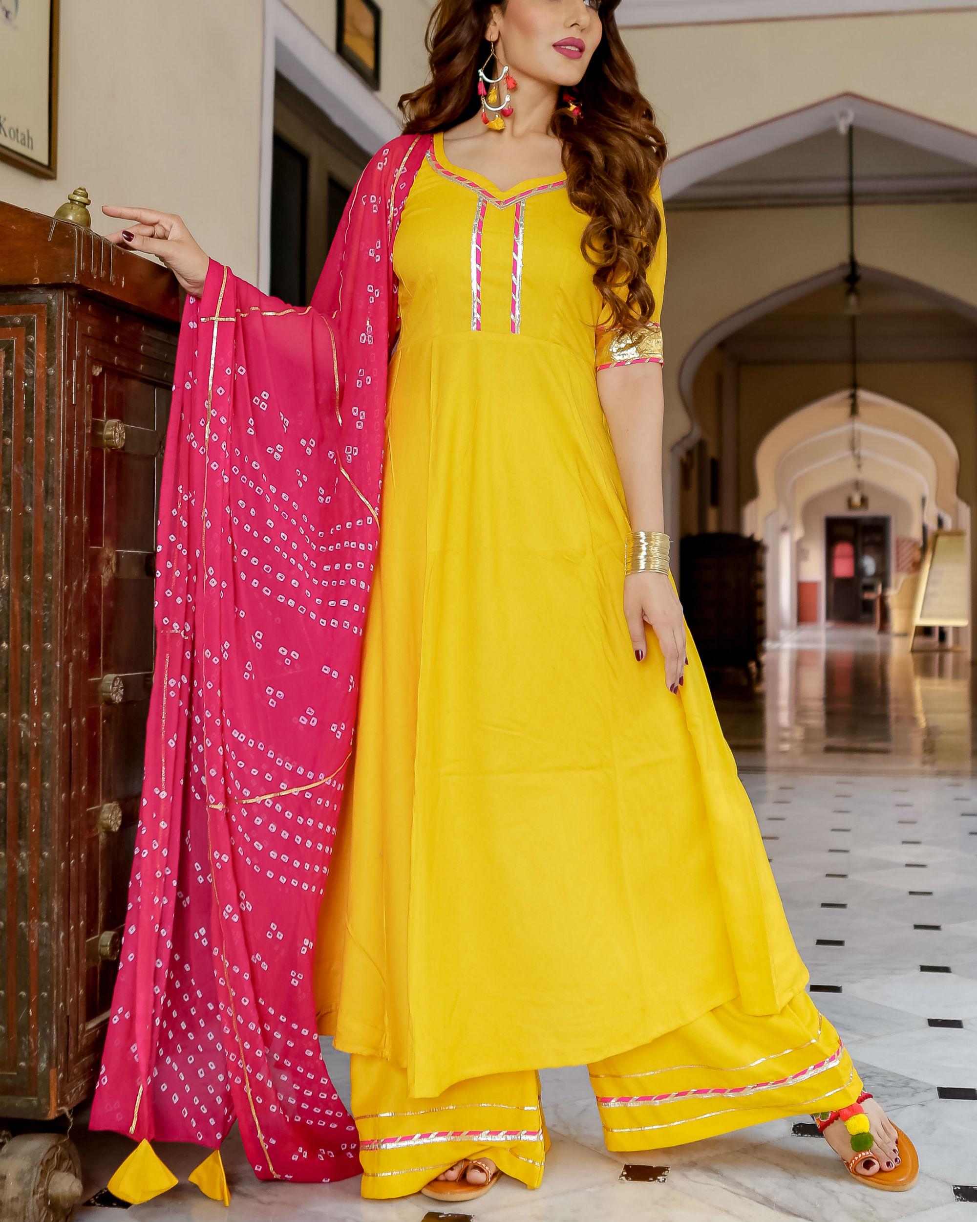 33d92669119 Yellow kurta set with bandhani dupatta by Aachho