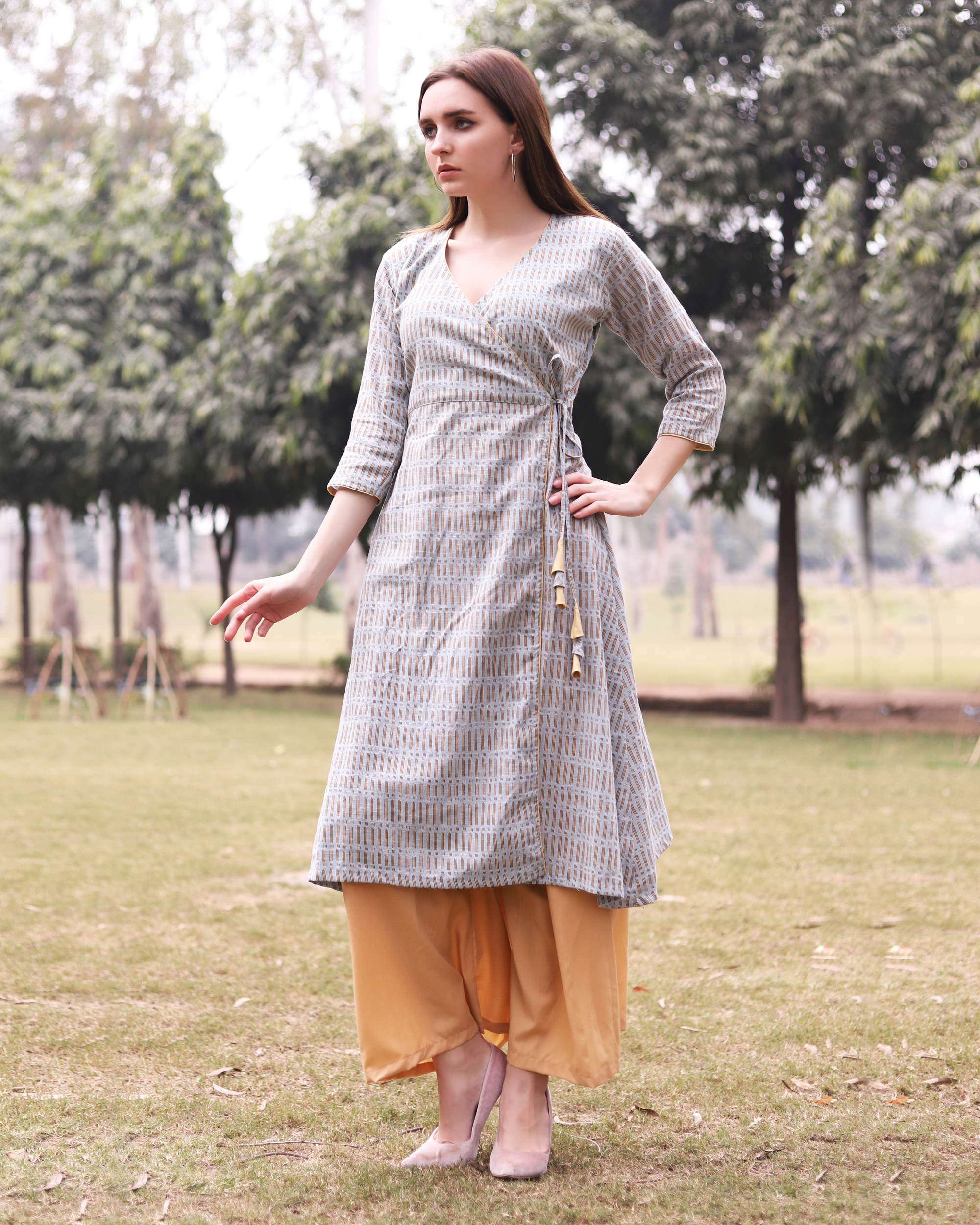 Grey printed angrakha kurta with flared gold pants
