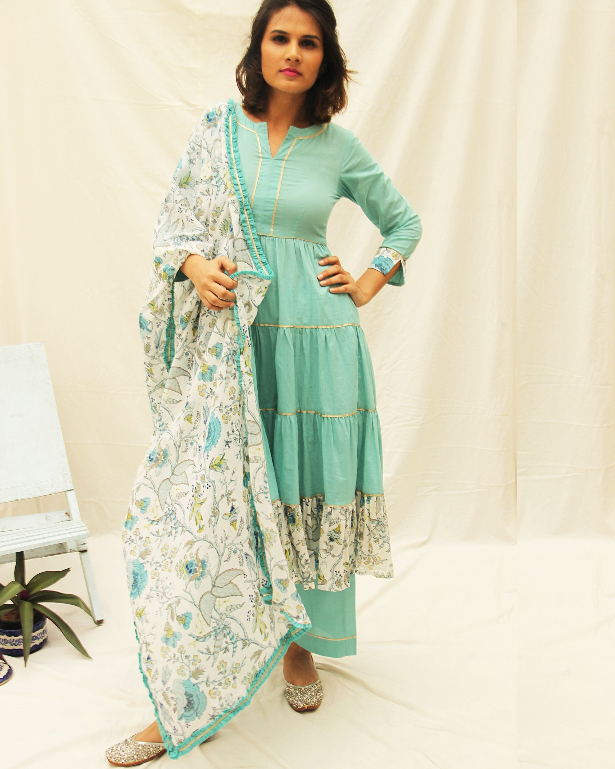 Plain blue frilled kurta with Gota details paired with blue pants and printed floral dupatta - set of three