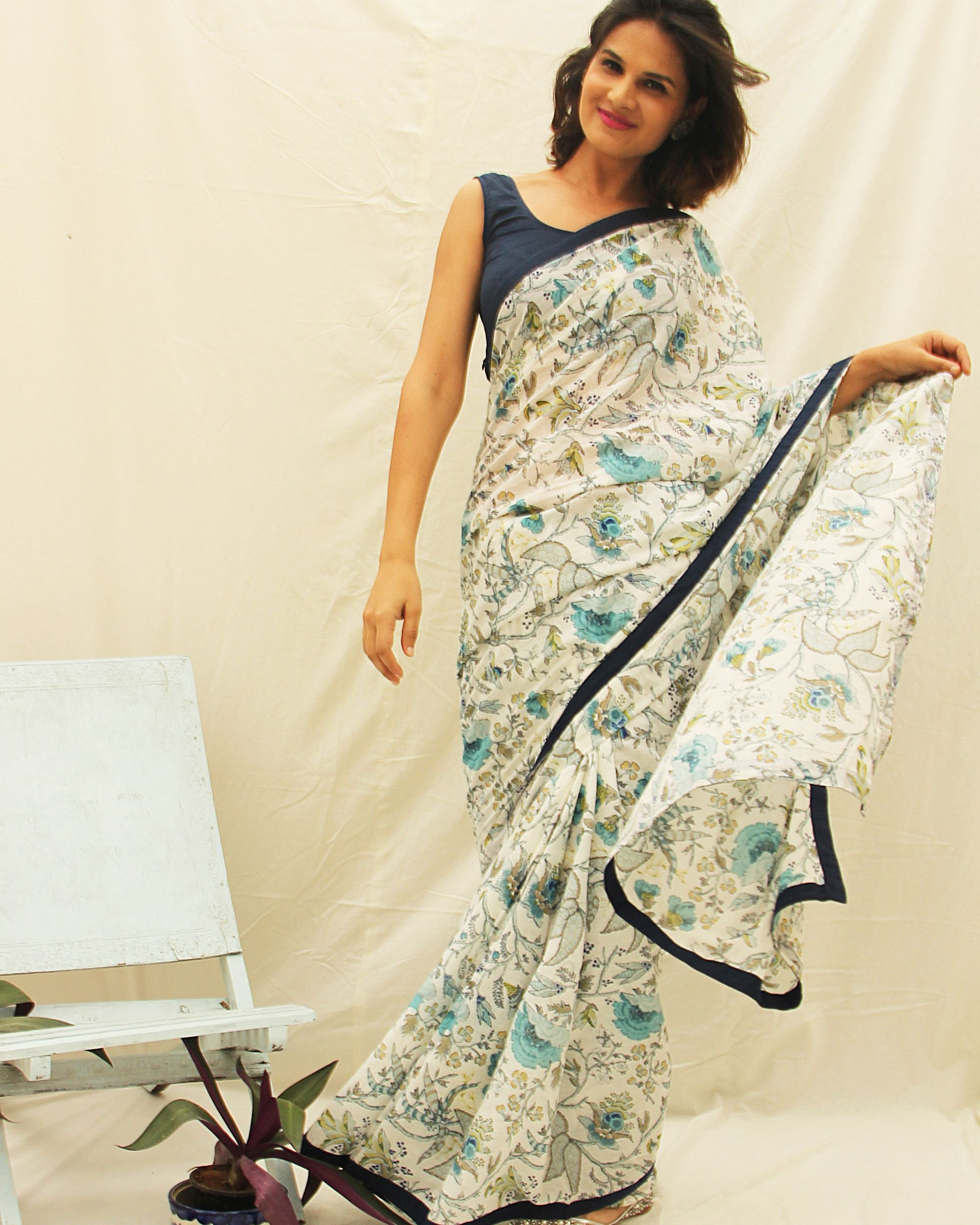 White printed cotton saree with all around black border detailing.