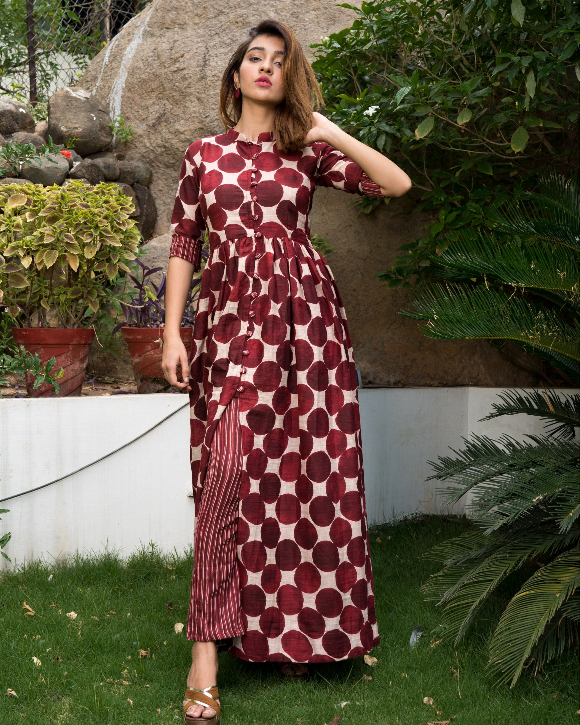 Maroon colored polka dot kurta with striped pants - set of two.