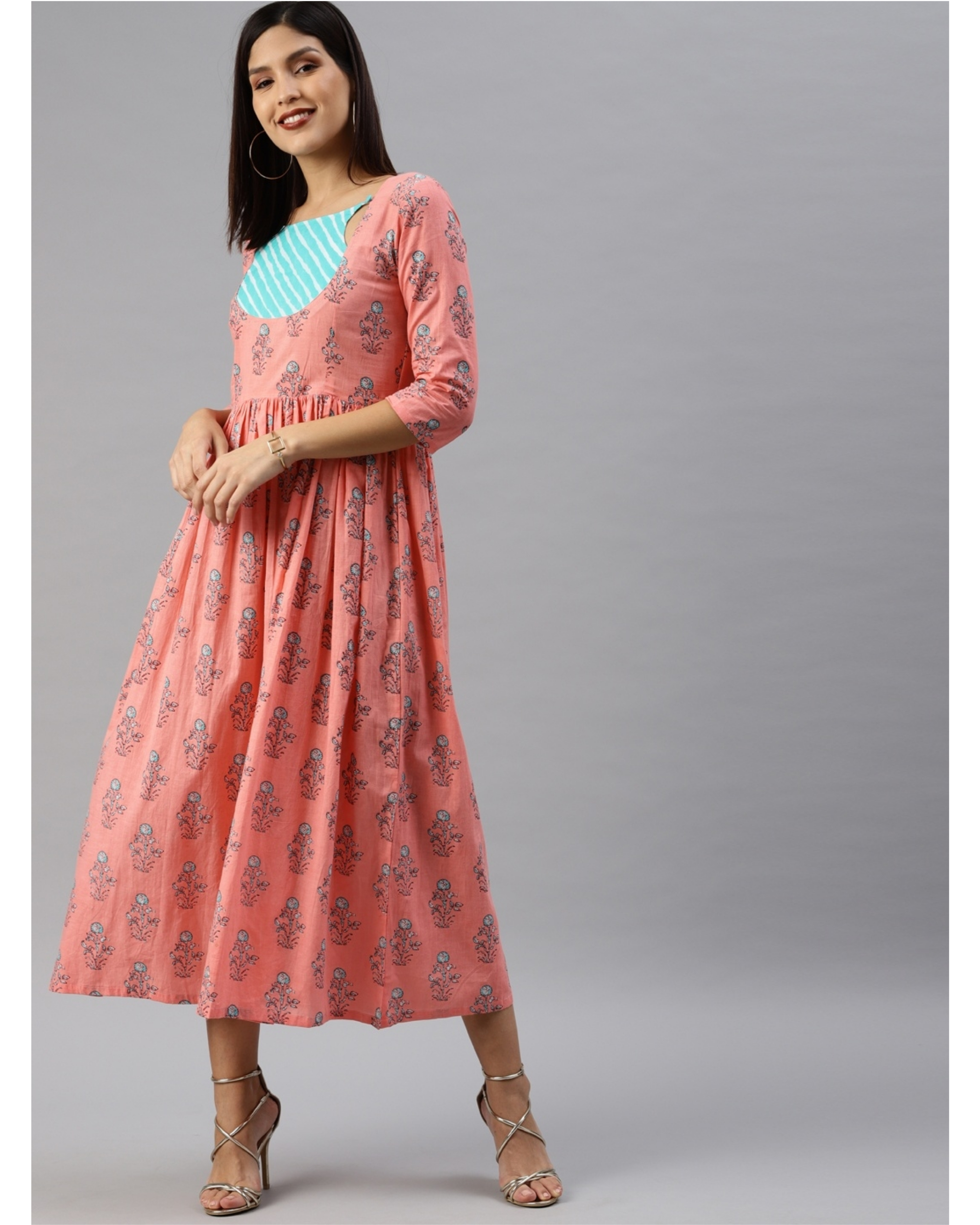 Peach printed a-line dress with turquoise yoke
