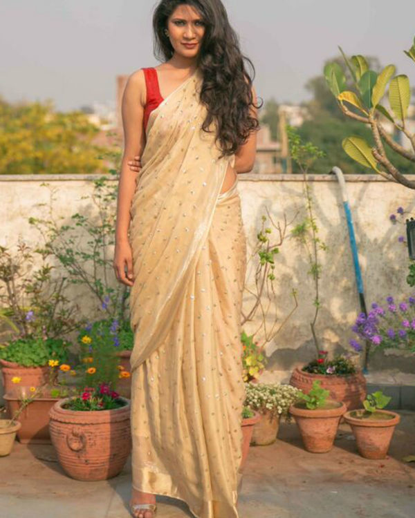 Beige saree with golden sequins