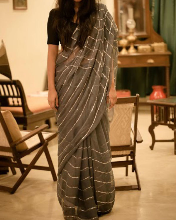 Grey chiffon saree with checks and stripes