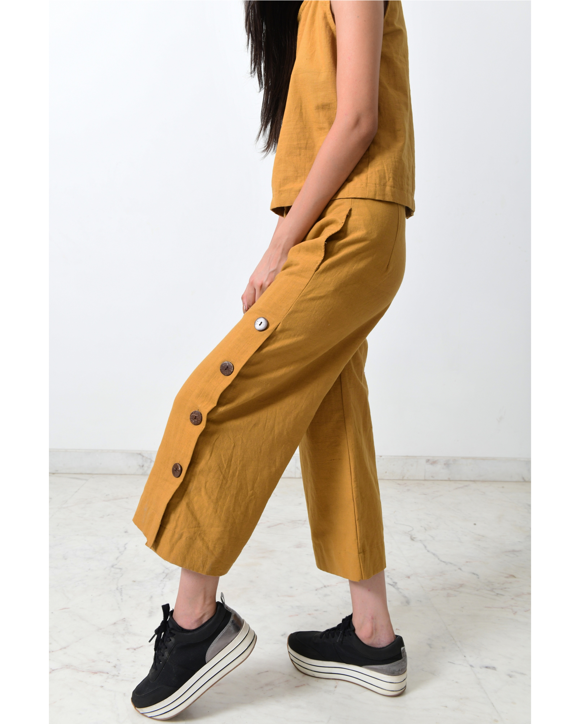 Pale mustard side open pants with buttons detailing