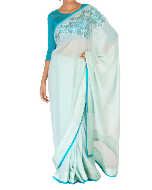 Sea green crystal work sari with a azure blouse
