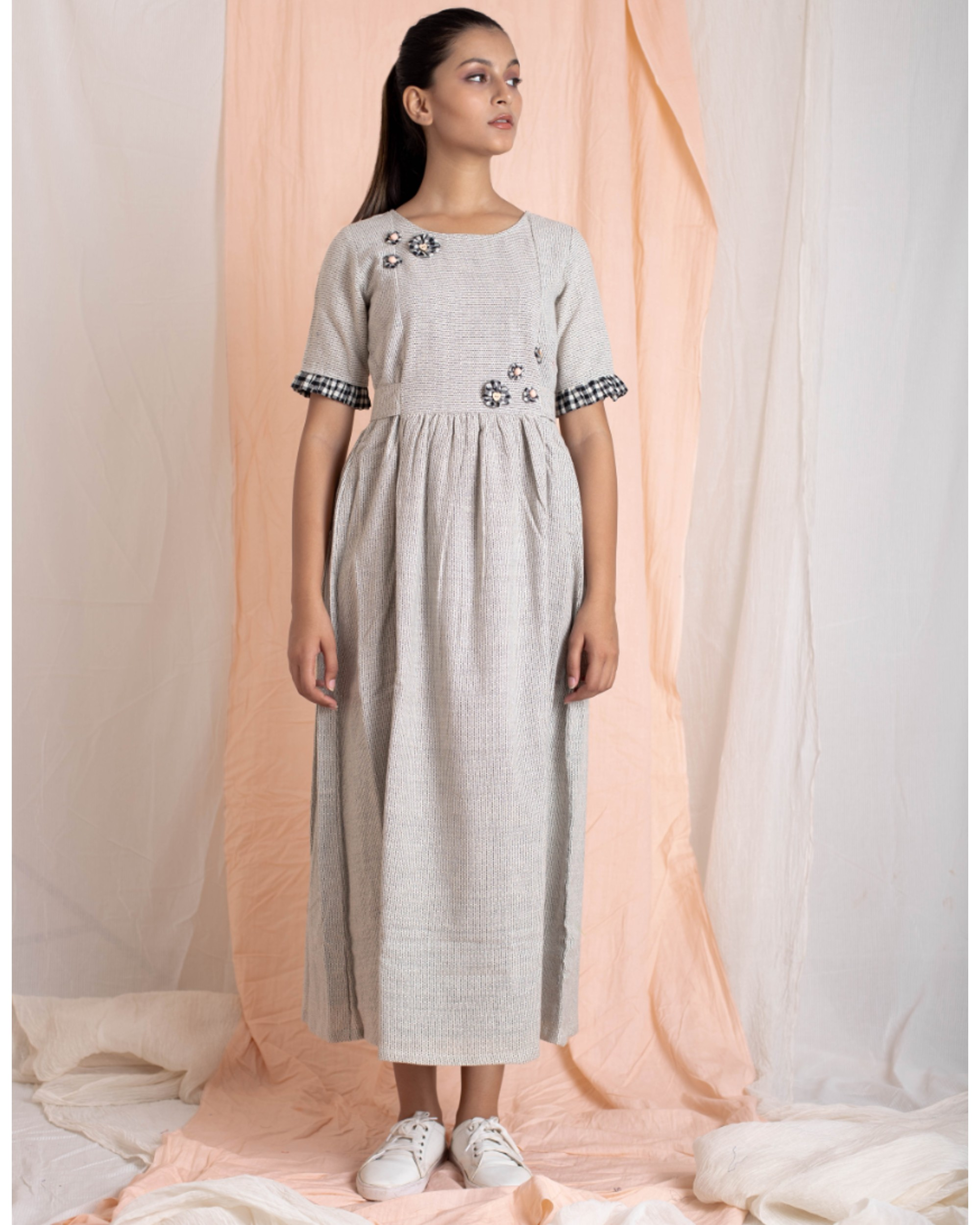 Light grey hand-woven gathered dress with applique work