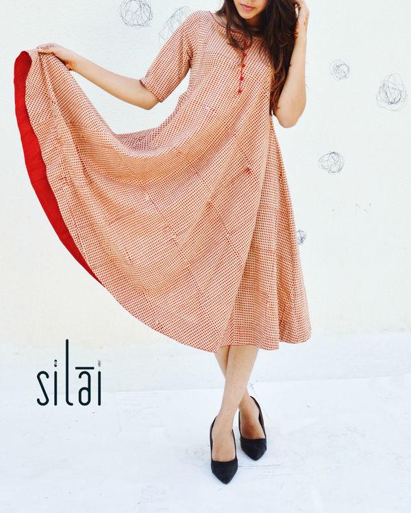 Red polka printed flared dress