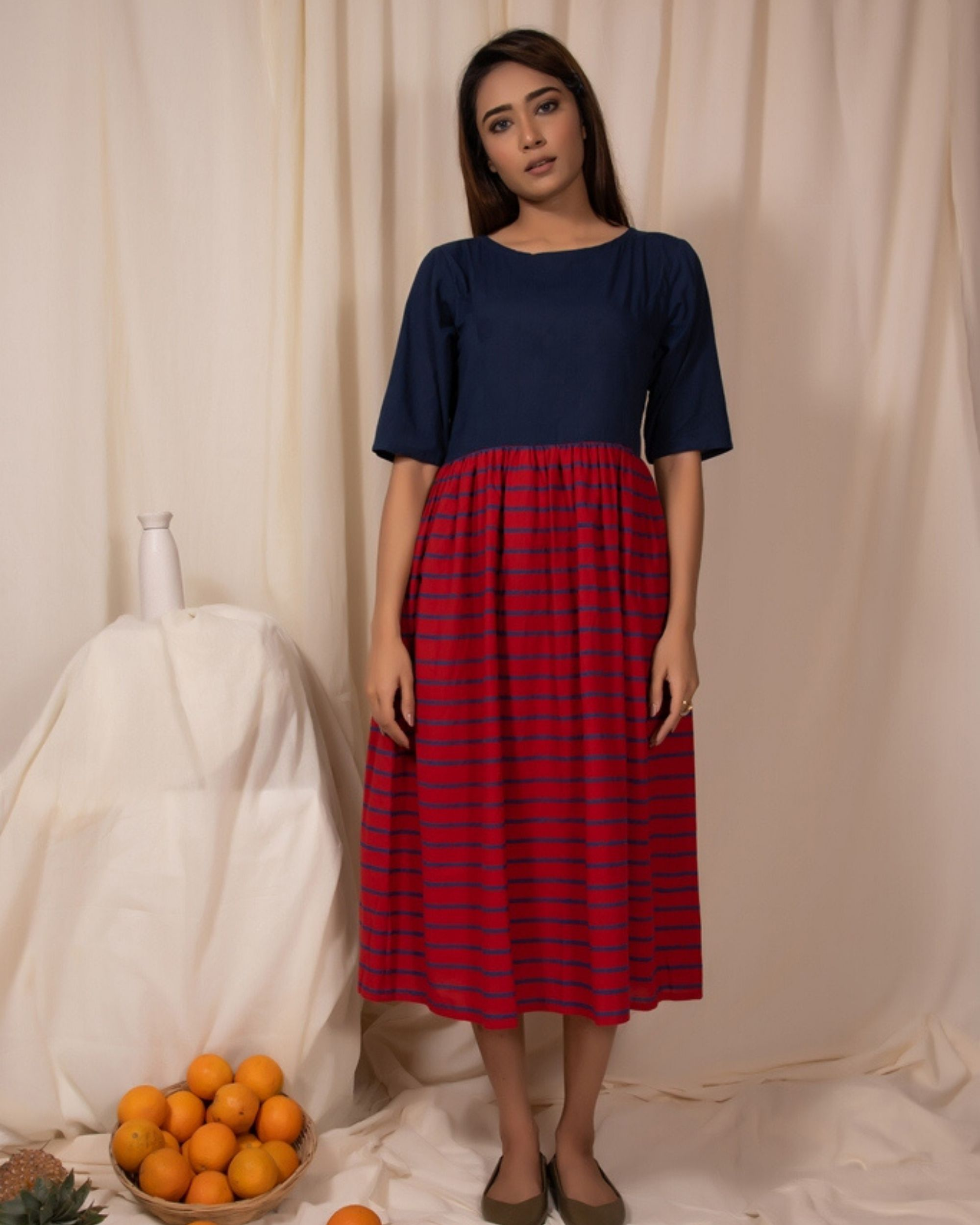 Indigo and red gathered dress with stripes detailing