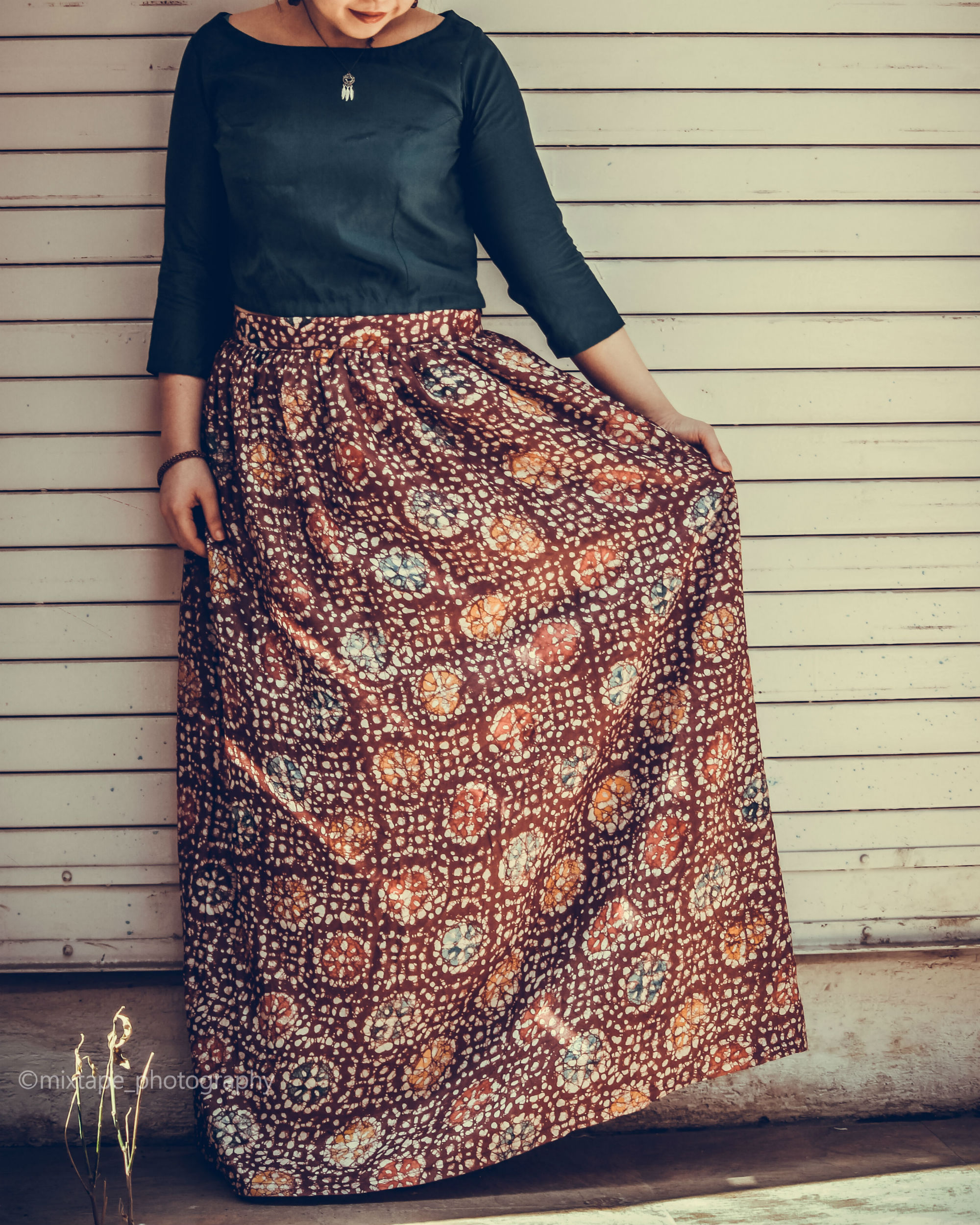 Teal top with batik coffee skirt