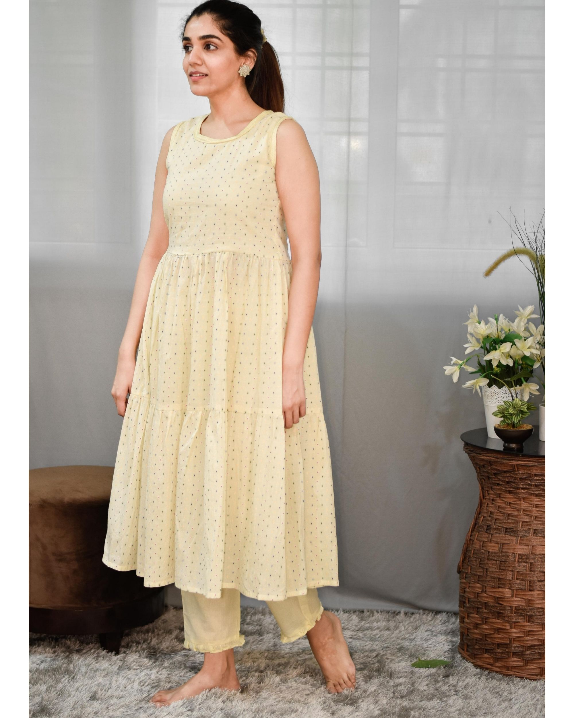 Pastel yellow printed tiered kurta and pants - Set Of Two