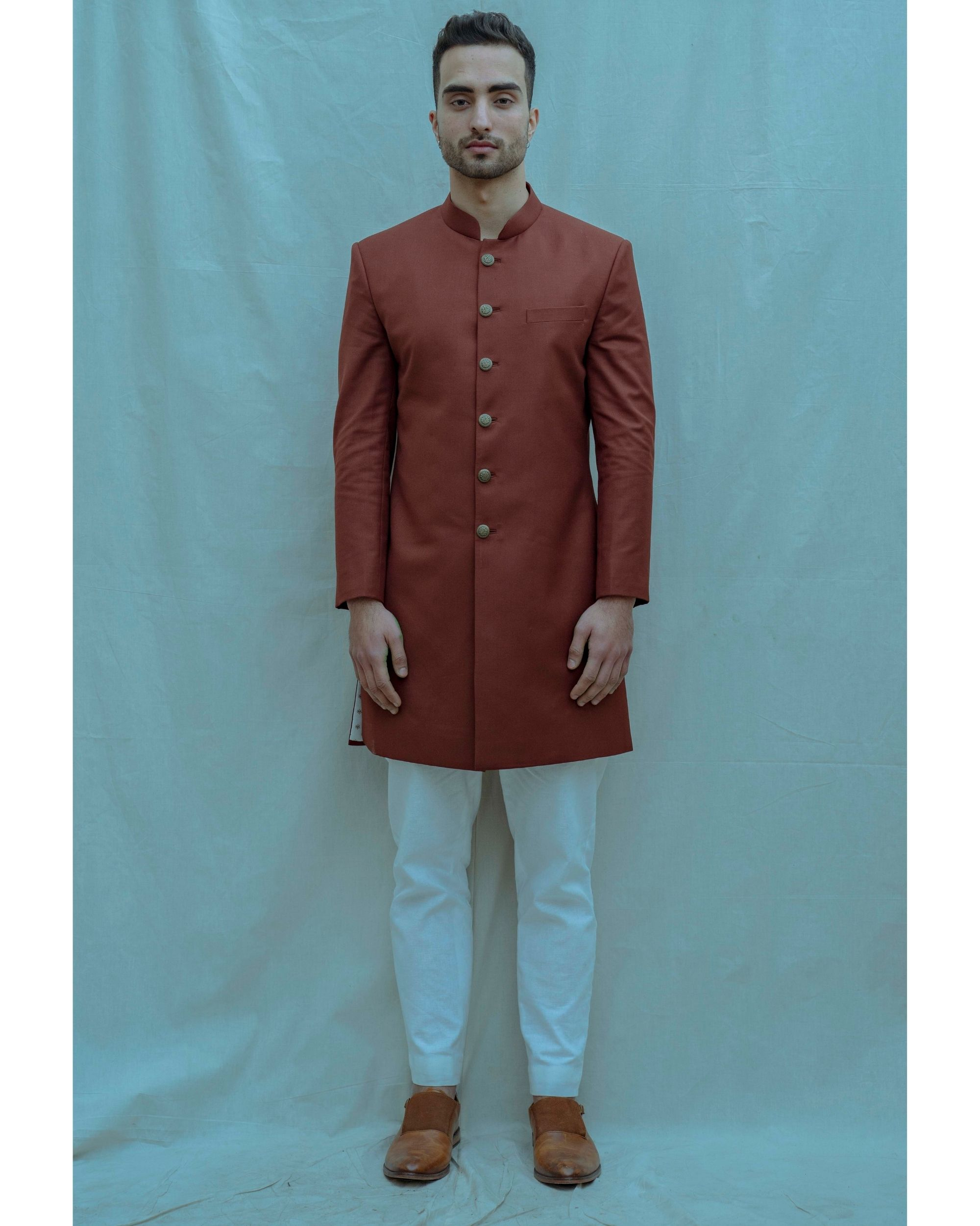 Rust hued achkan and white kurta with pants - Set Of Three