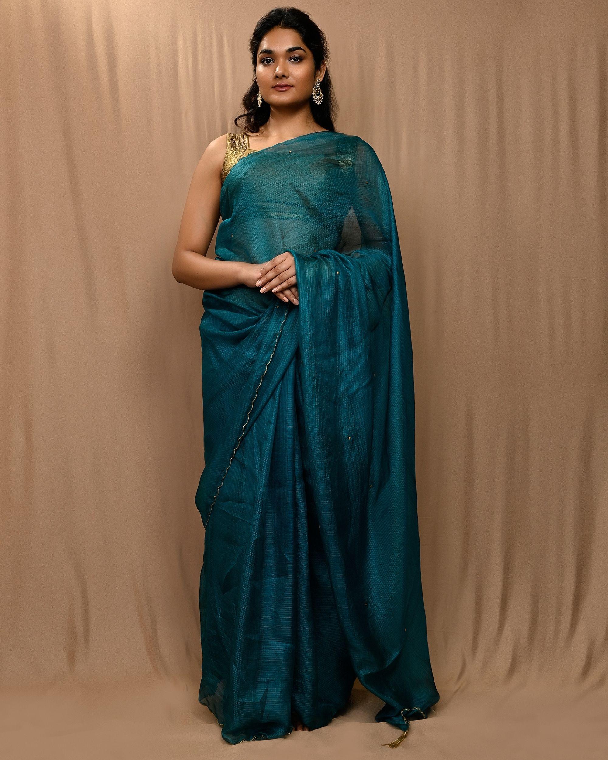 Teal green embroidered kota silk scalloped sari