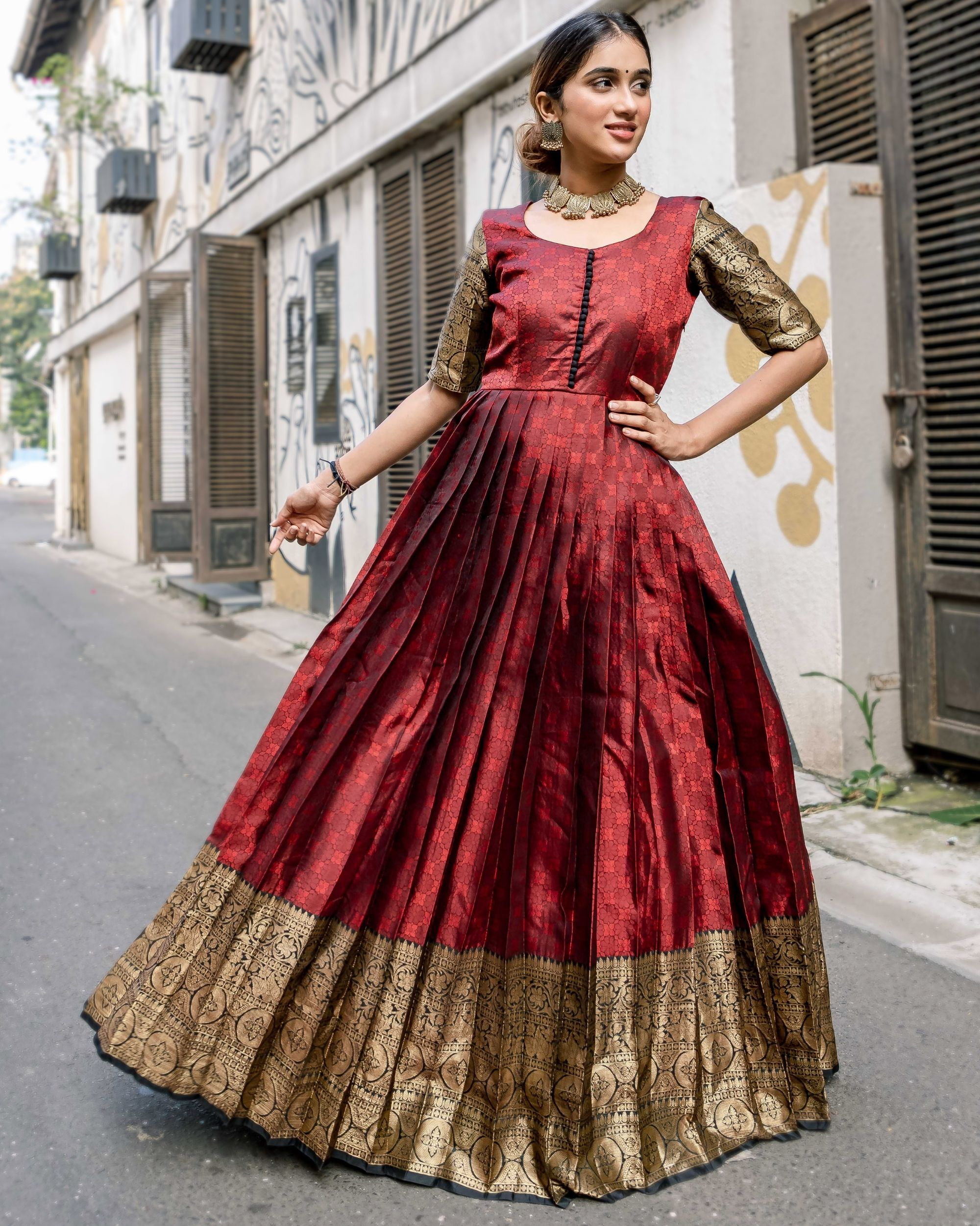 Red floral motif pleated dress with zari border detailing
