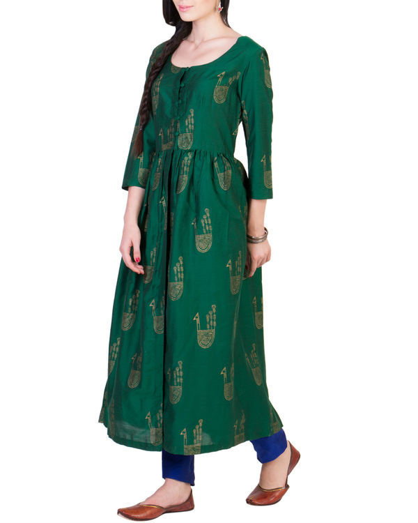 Green tunic with blue pleated pants