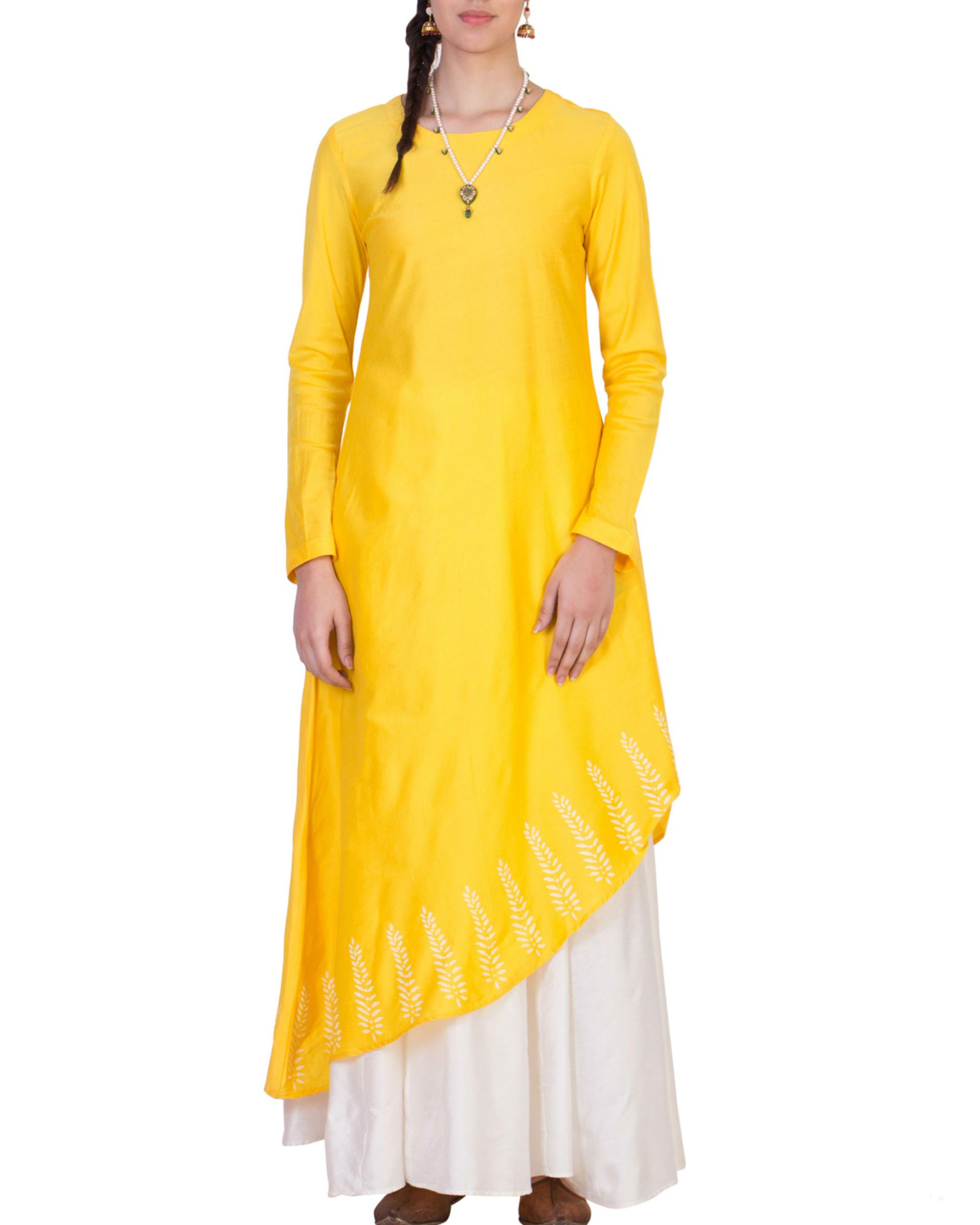 Yellow tunic with white skirt