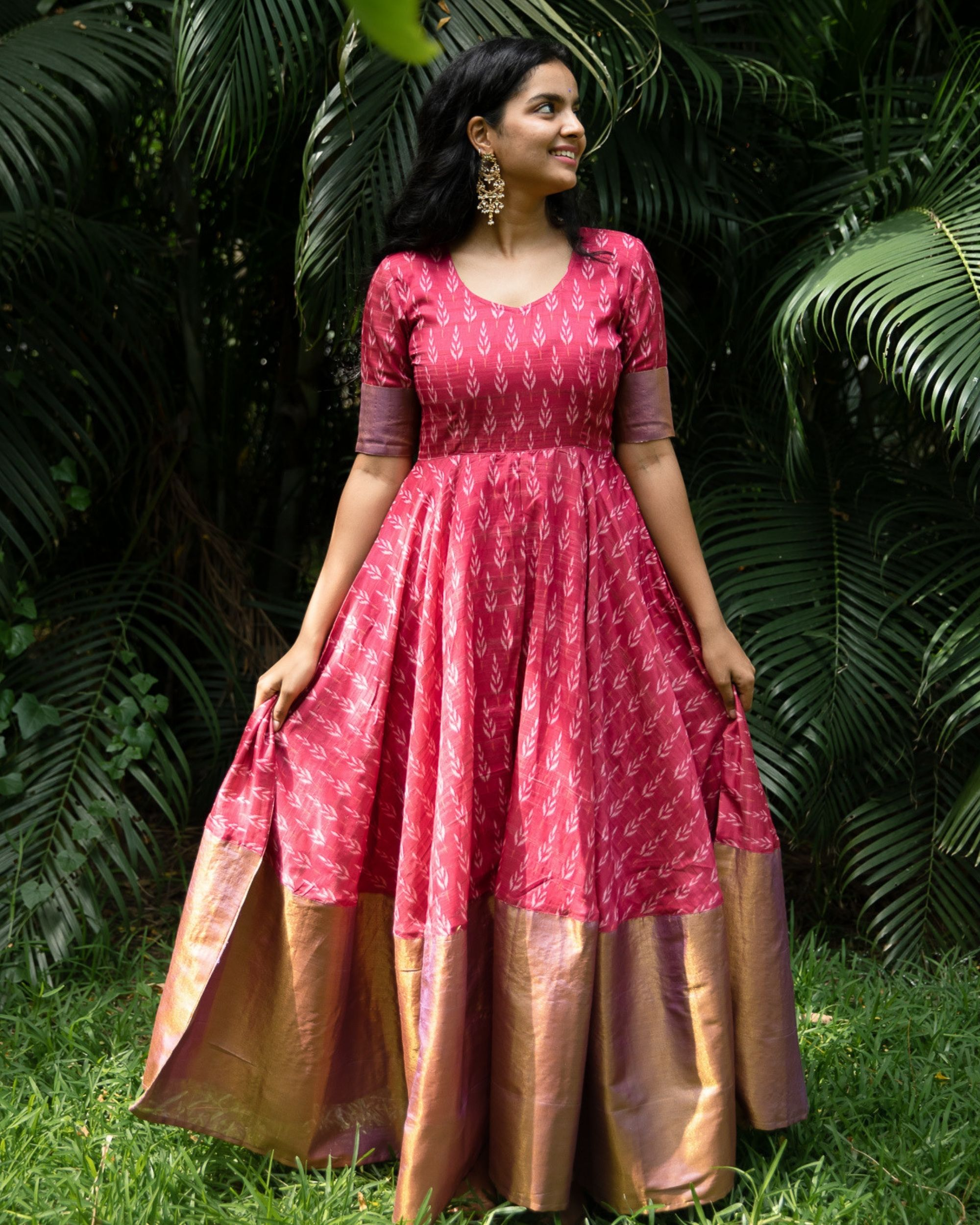 Pink ikat flared dress with silk border