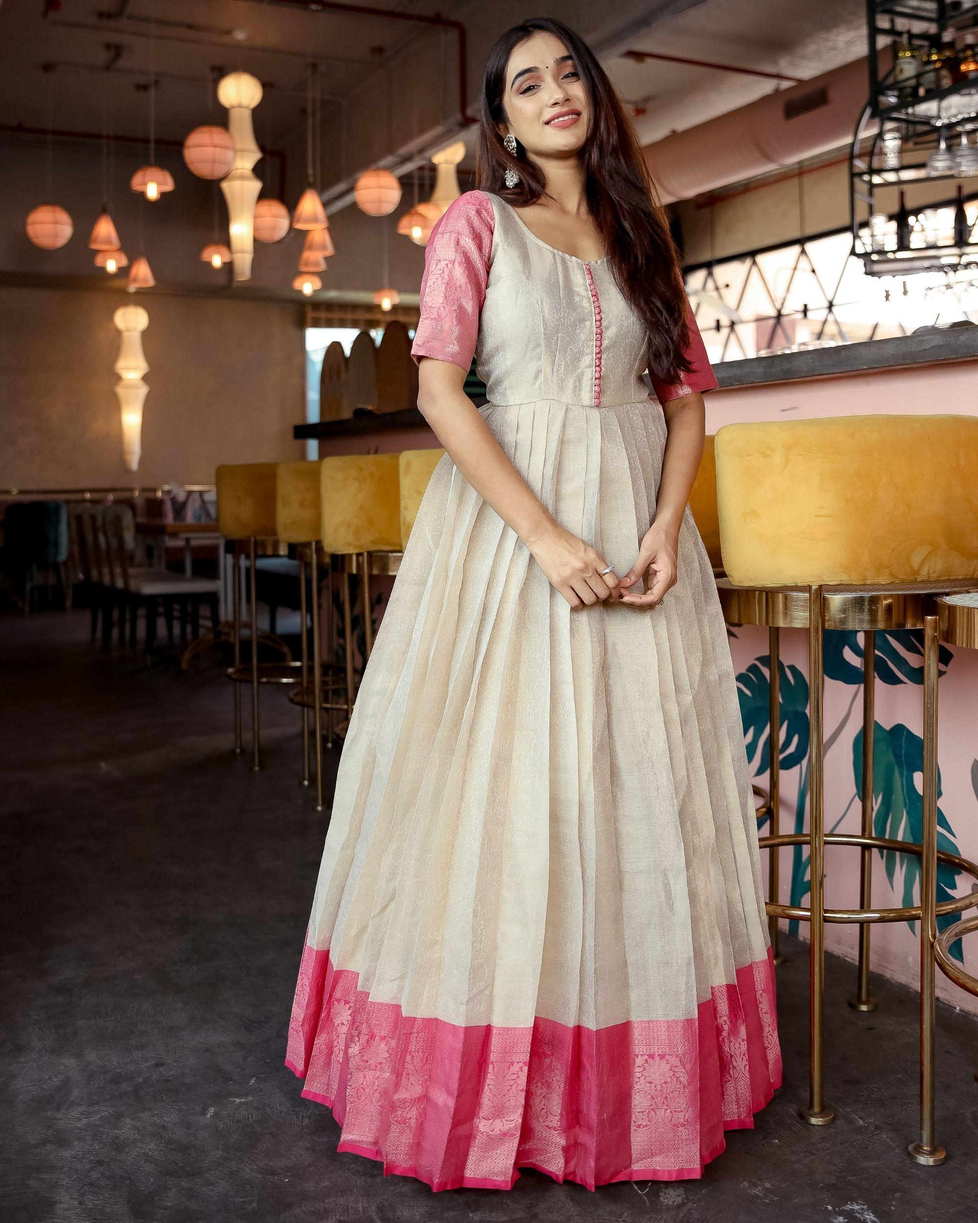 Cream silk pleated gown
