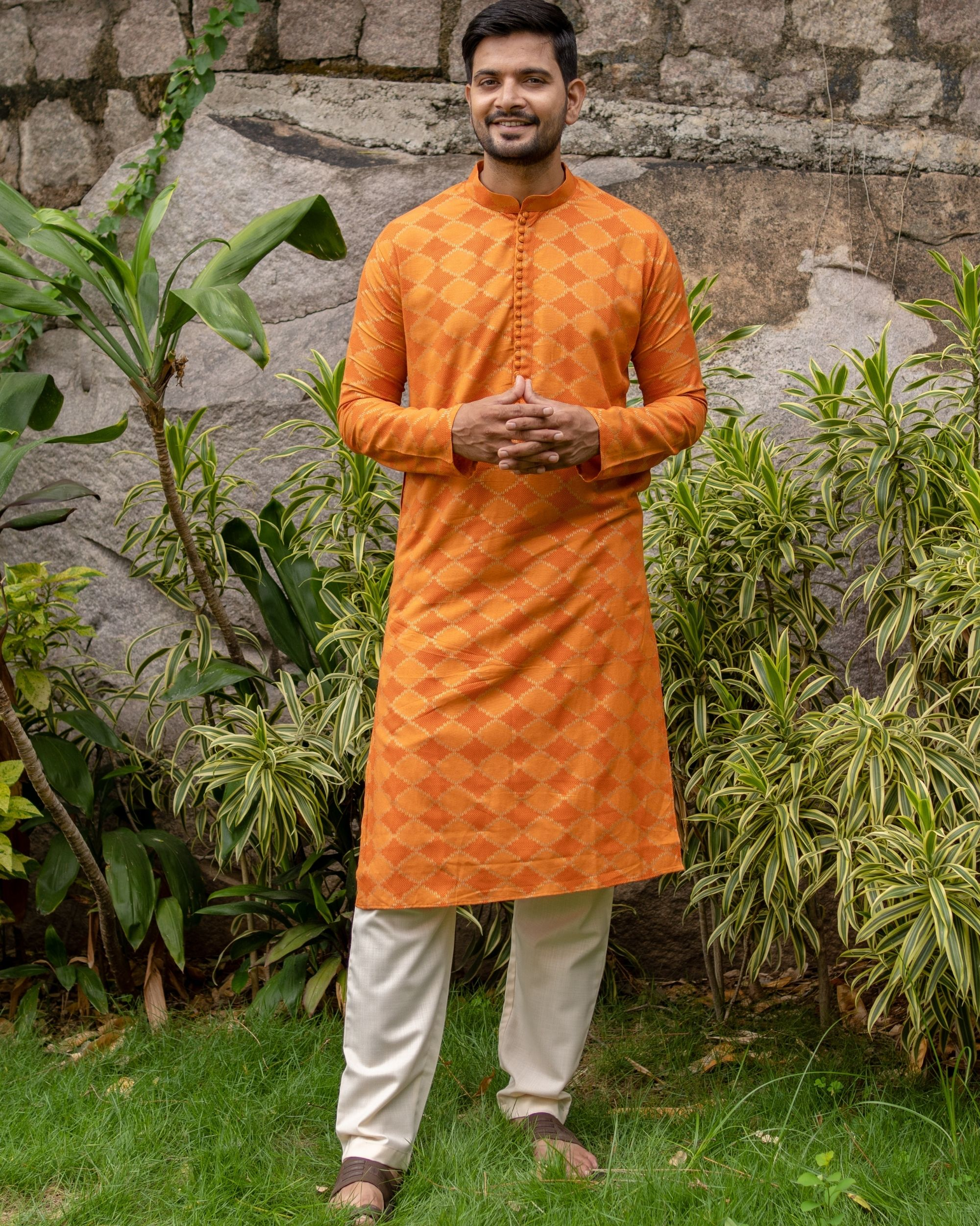 Orange and golden printed checkered kurta with off white pants - set of two