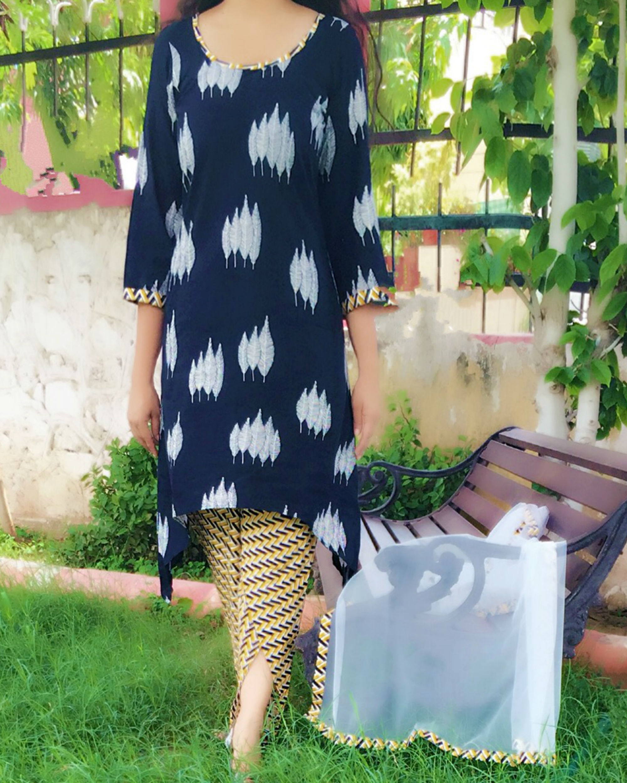 Set of black kurta with dhoti pants and dupatta